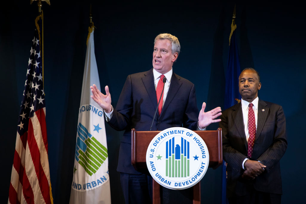 New York City Mayor Bill de Blasio and Ben Carson, Secretary of Housing and Urban Development (HUD), take questions after signing a ceremonial agreement between the federal government and the City of New York intended to correct mismanagement of the New York City Housing Authority (NYCHA), during a press conference at the Jacob Javits Federal Building, January 31, 2019 in New York City. On Sunday, de Blasio slammed Amazon.com Inc.'s decision to pull out of a second headquarters in the city as 'an example of an abuse of corporate power' that hurts working people.