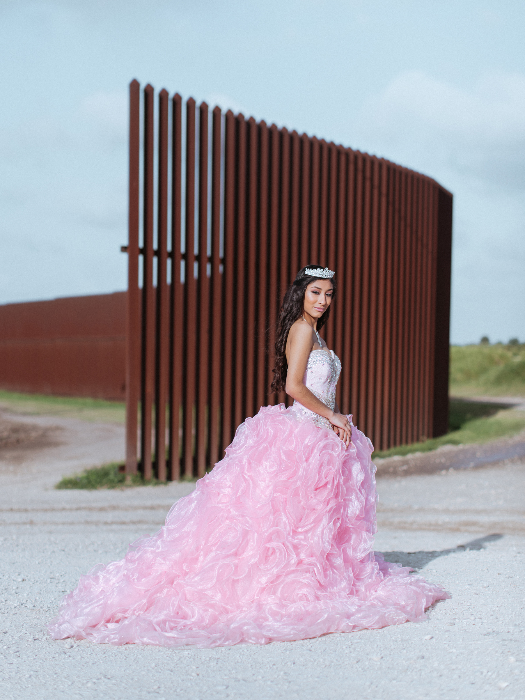Jaymin Martinez in her quinceanera dress next to the border fence, Brownsville, Texas.