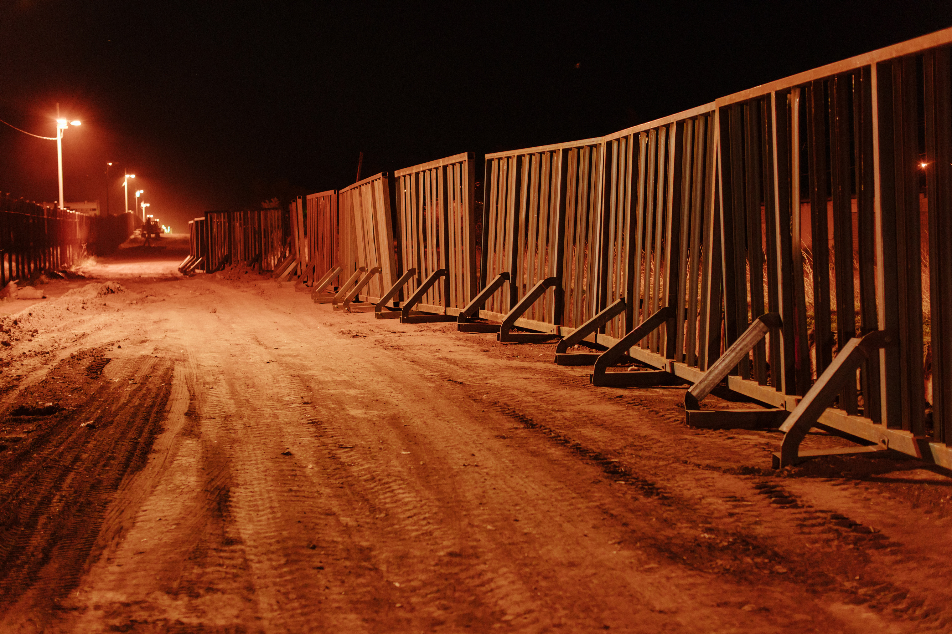 Temporary fence structure during construction of new fence in Naco, Ariz.