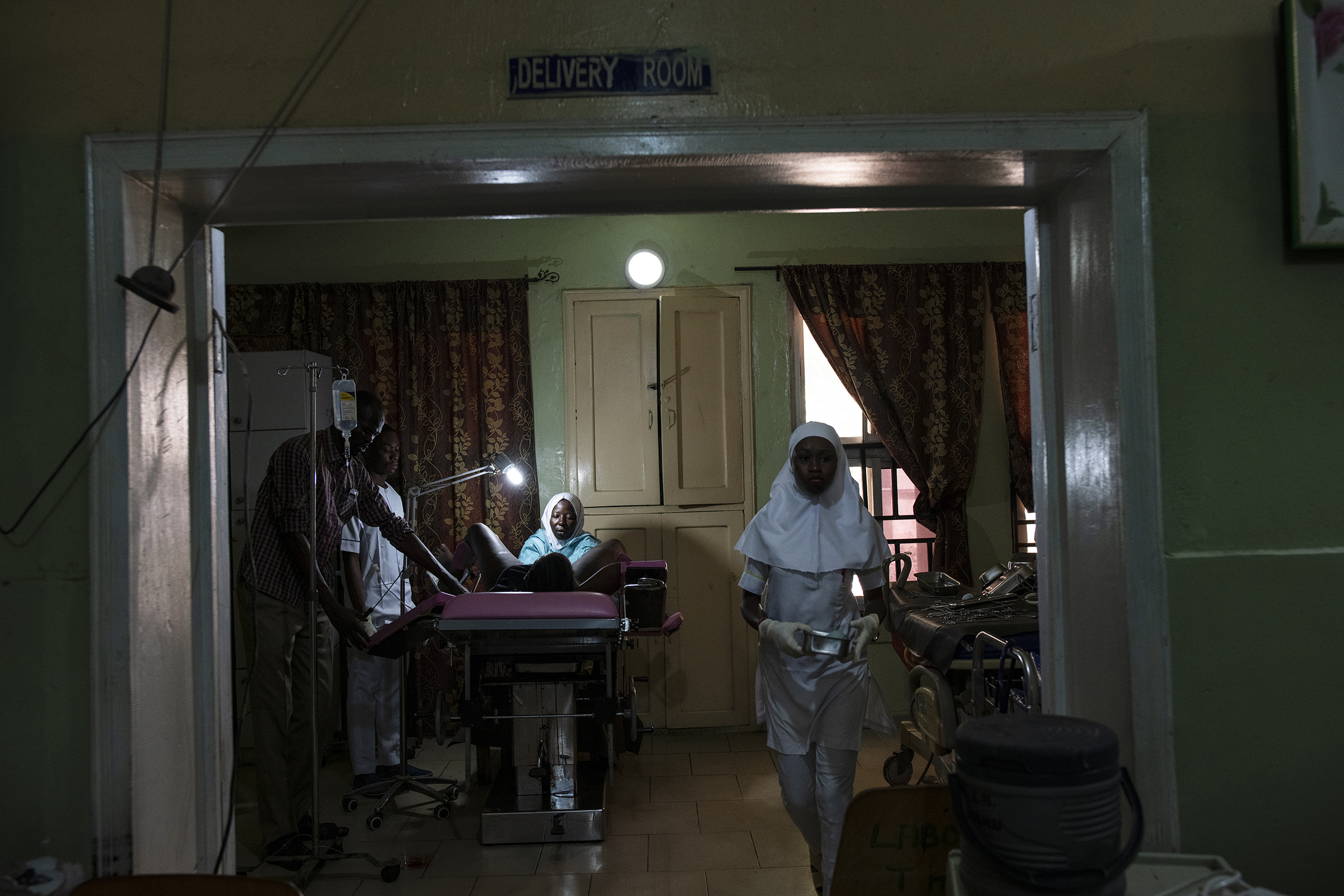 A senior midwife at the State Specialist Hospital in Maiduguri sutures a woman who has just given birth