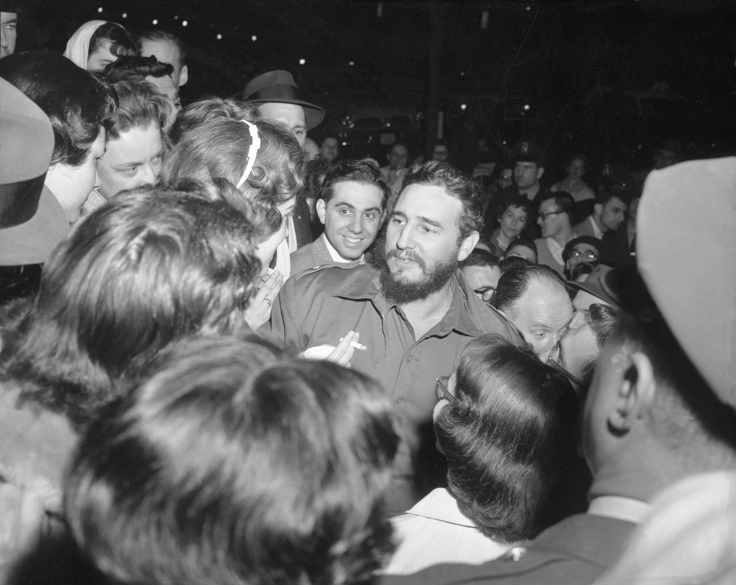 Cuban Prime Minister Fidel Castro greets admirers who waited for him across the street from the Cuban Embassy in Washington, D.C., in 1959.