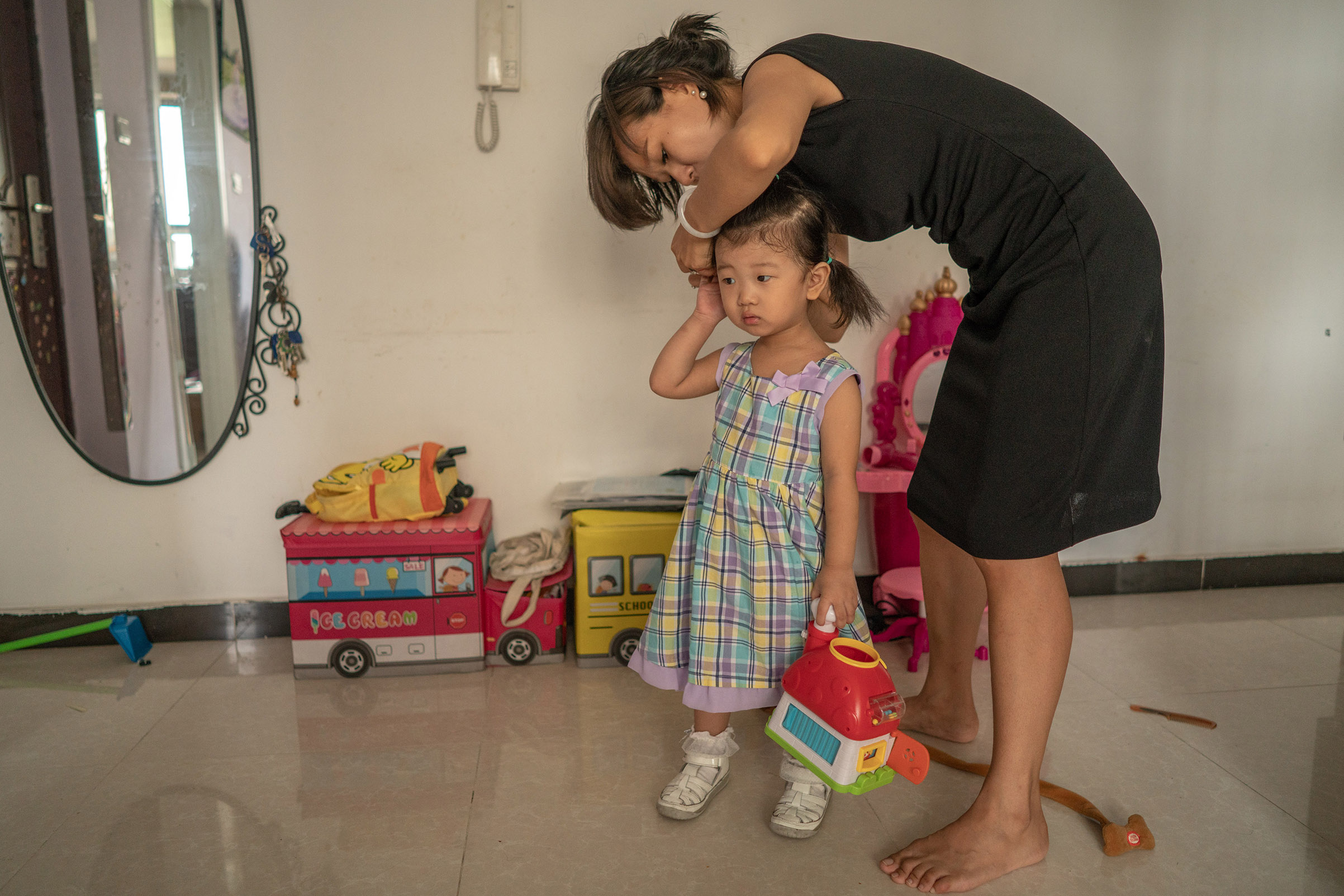 Ma Ying, 30, says she and her husband would prefer to raise their daughter Sang Tianyi, 3, as an only child