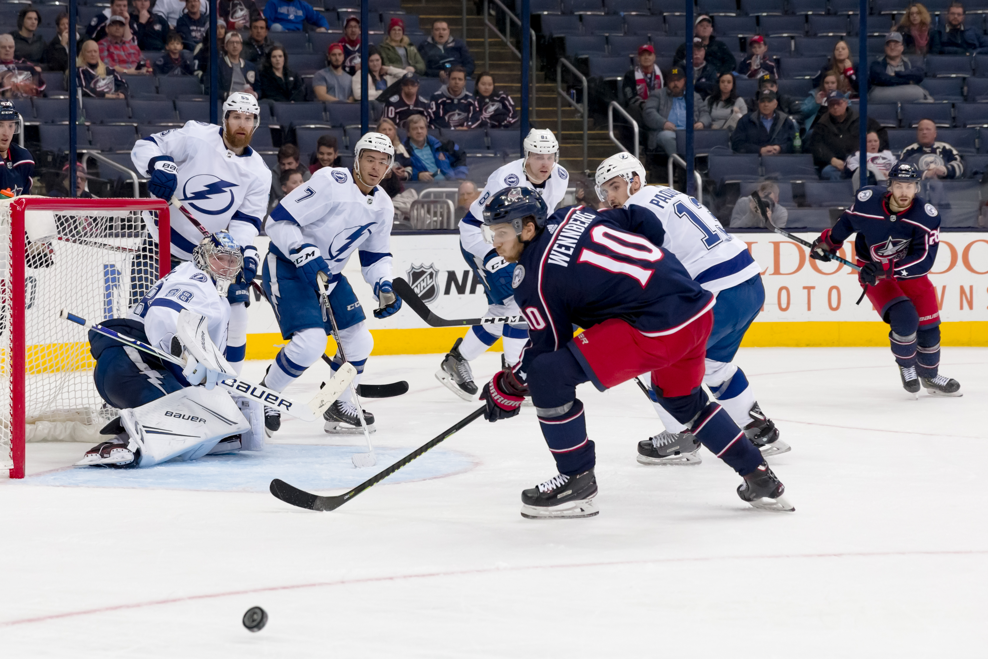 Tampa Bay Lightning goaltender Andrei Vasilevskiy (88) deflects a shot from Columbus Blue Jackets center Alexander Wennberg (10) in a game between the Columbus Blue Jackets and the Tampa Bay Lightning on February 18, 2019 at Nationwide Arena in Columbus, OH.