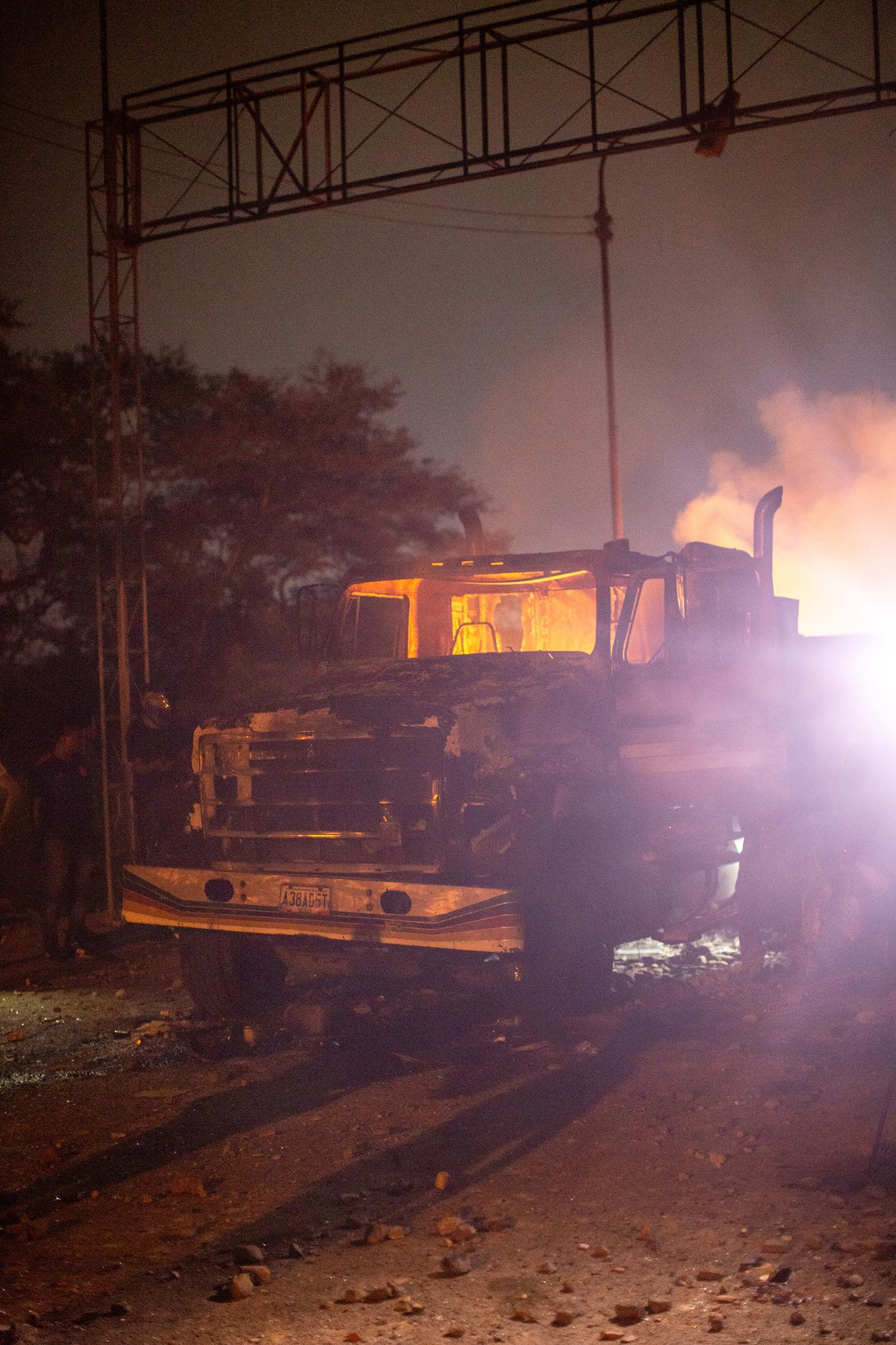 An aid truck burns on the Venezuelan side of a border bridge near the town of Ureña on Feb. 23, 2019.