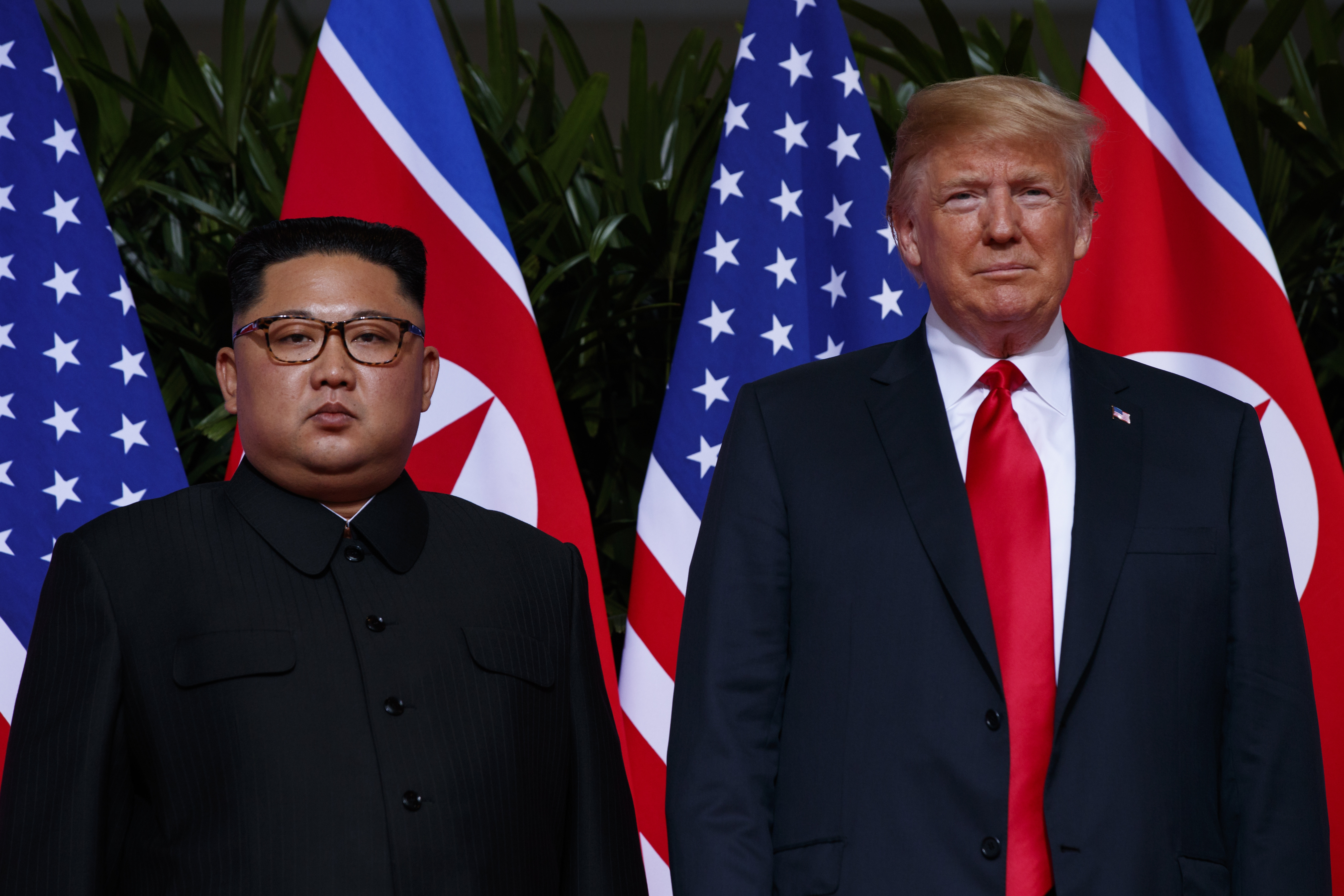In this June 12, 2018, photo, U.S. President Donald Trump stands with North Korean leader Kim Jong Un during a meeting on Sentosa Island, in Singapore. For some observers, the nightmare result of the second summit between Trump and Kim is an ill-considered deal that allows North Korea to get everything it wants while giving up very little, even as the mercurial leaders trumpet a blockbuster nuclear success.