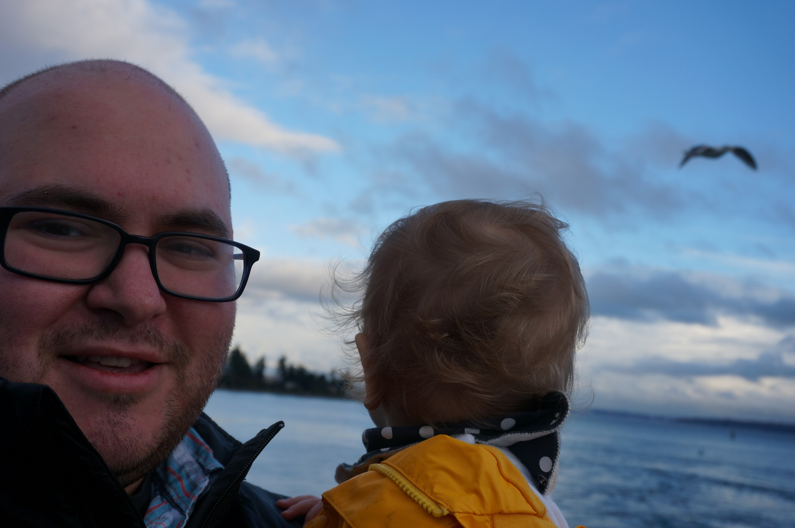 Elias Kass with his child. Kass is a Seattle naturopathic pediatric primary care provider who advocates for parents to vaccinate their children.