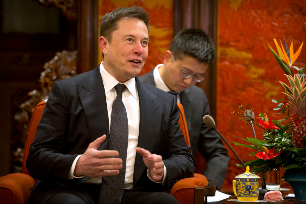 Tesla CEO Elon Musk speaks during a meeting with Chinese Premier Li Keqiang (not pictured) at the Zhongnanhai leadership compound in Beijing on Jan. 9, 2019. It was announced on Feb. 19, 2019 that Tesla's general counsel would be leaving just two months after being hired when Tusk go into trouble with the SEC.