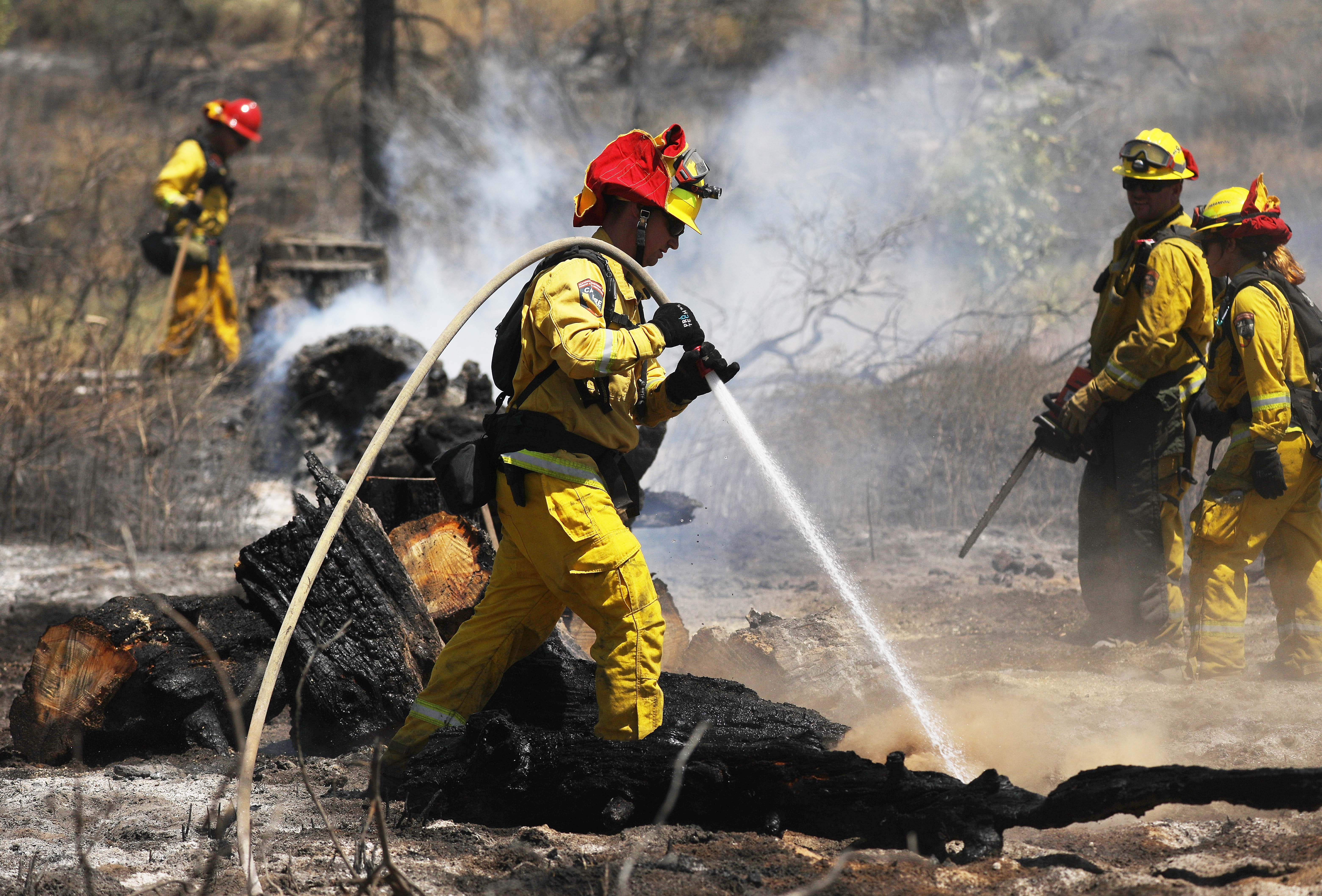 Firefighters work as the Cranston Fire burns in San Bernardino National Forest near Idyllwild, Calif., on July 26, 2018.