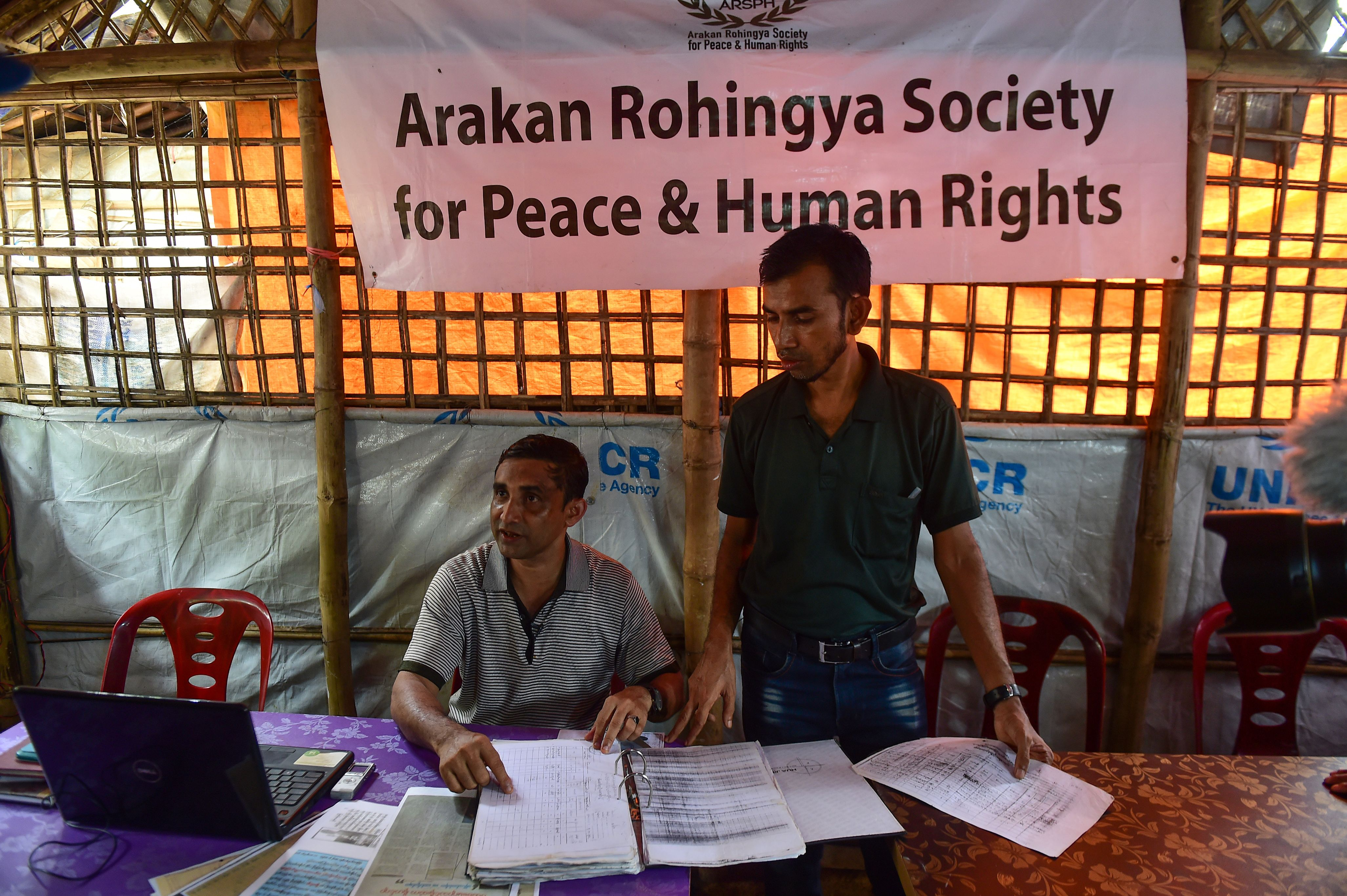 Rohingya activists collect testimony from refugees who suffered alleged abuses by Myanmar soldiers, at the Kutupalong refugee camp in Ukhia, Bangladesh on July 19, 2018.