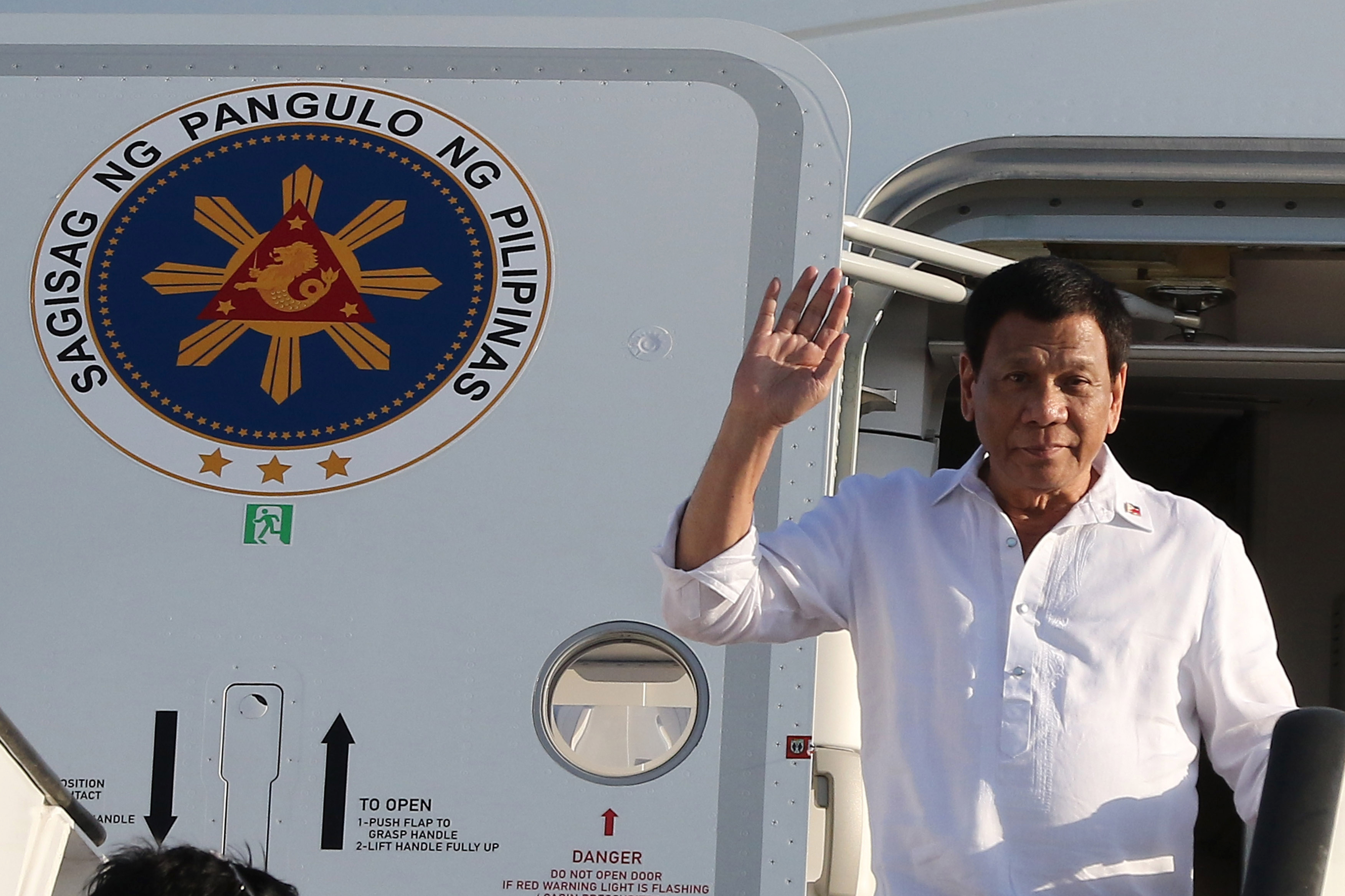 Philippine President Rodrigo Duterte waves upon his arrival in Amman, Jordan on Sept. 5, 2018.