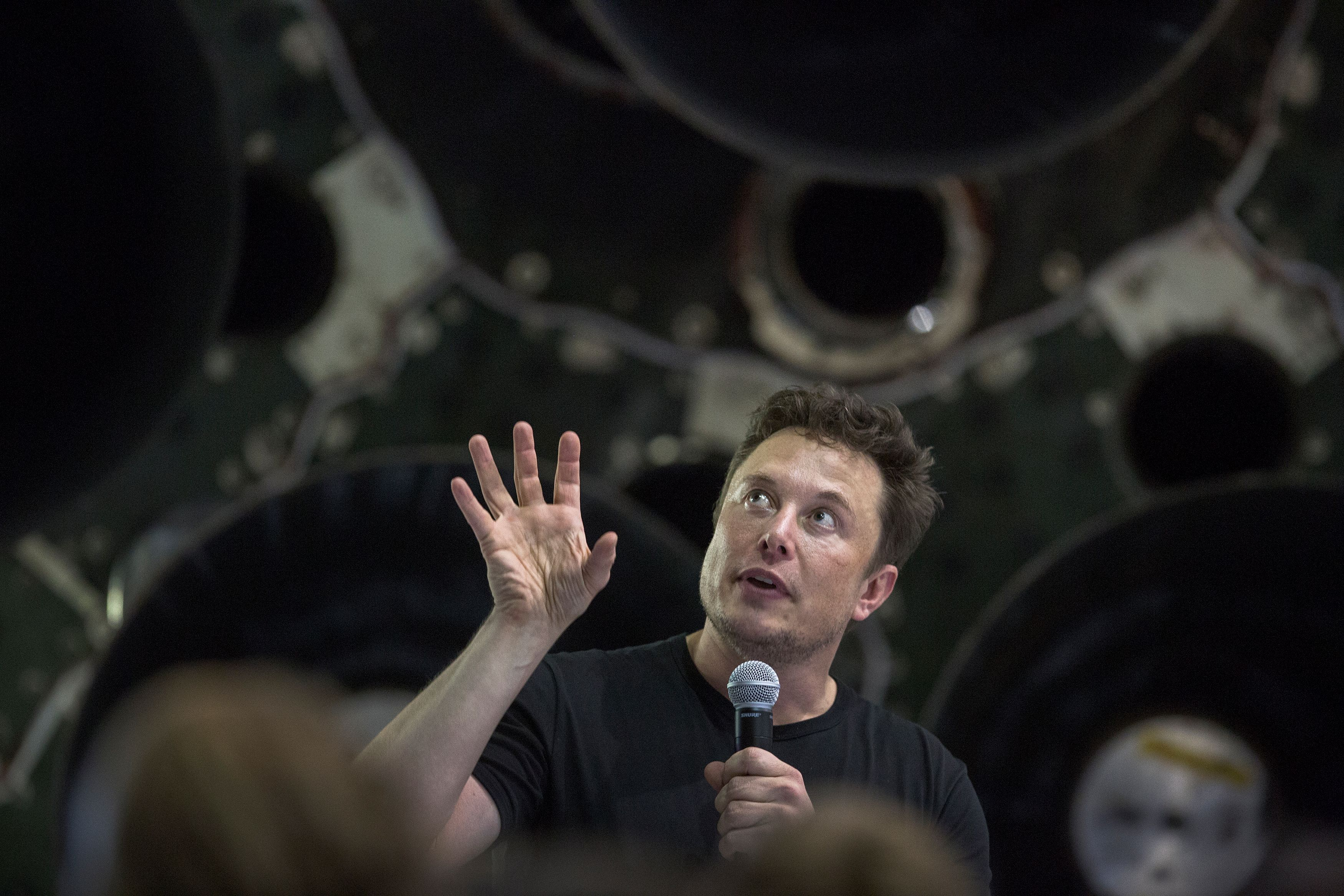 Elon Musk speaks near a Falcon 9 rocket at the SpaceX headquarters and rocket factory on Sept. 17, 2018 in Hawthorne, California.