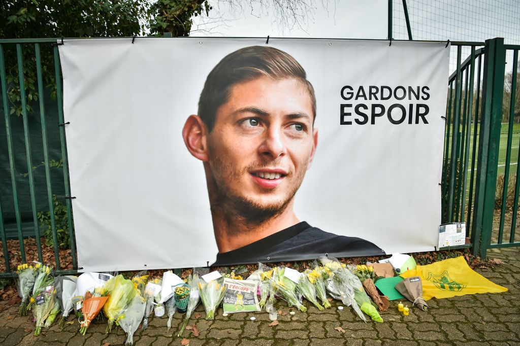Flowers are laid under a portrait of Argentine forward Emiliano Sala prior to a team training session at the FC Nantes training centre La Joneliere in La Chapelle-sur-Erdre, western France, on Jan. 24, 2019.