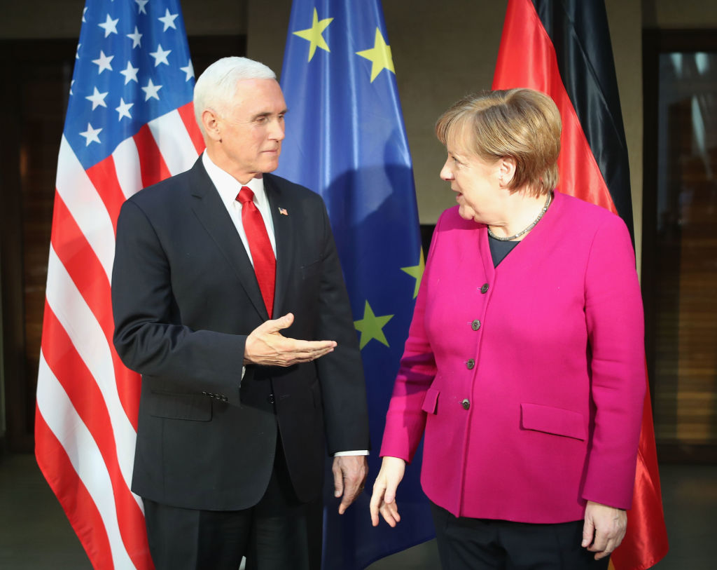 German Chancellor Angela Merkel (R) and US vice president Mike Pence chat during a photocall before biliteral talks during the 55th Munich Security Conference (MSC) on Feb. 16, 2019 in Munich, Germany