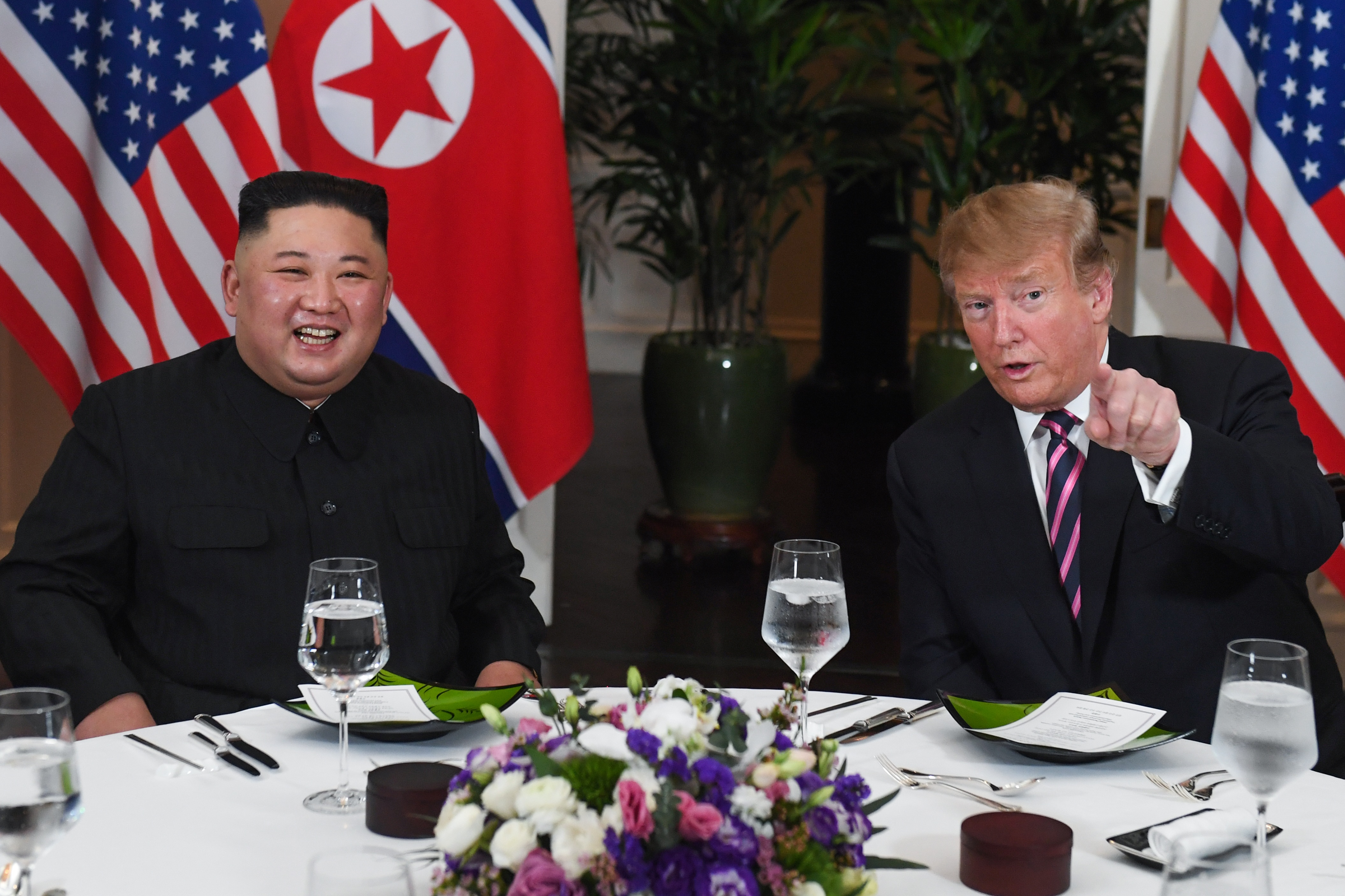 President Donald Trump and North Korea's leader Kim Jong Un sit for a dinner at the Sofitel Legend Metropole hotel in Hanoi, Vietnam on Feb. 27, 2019.