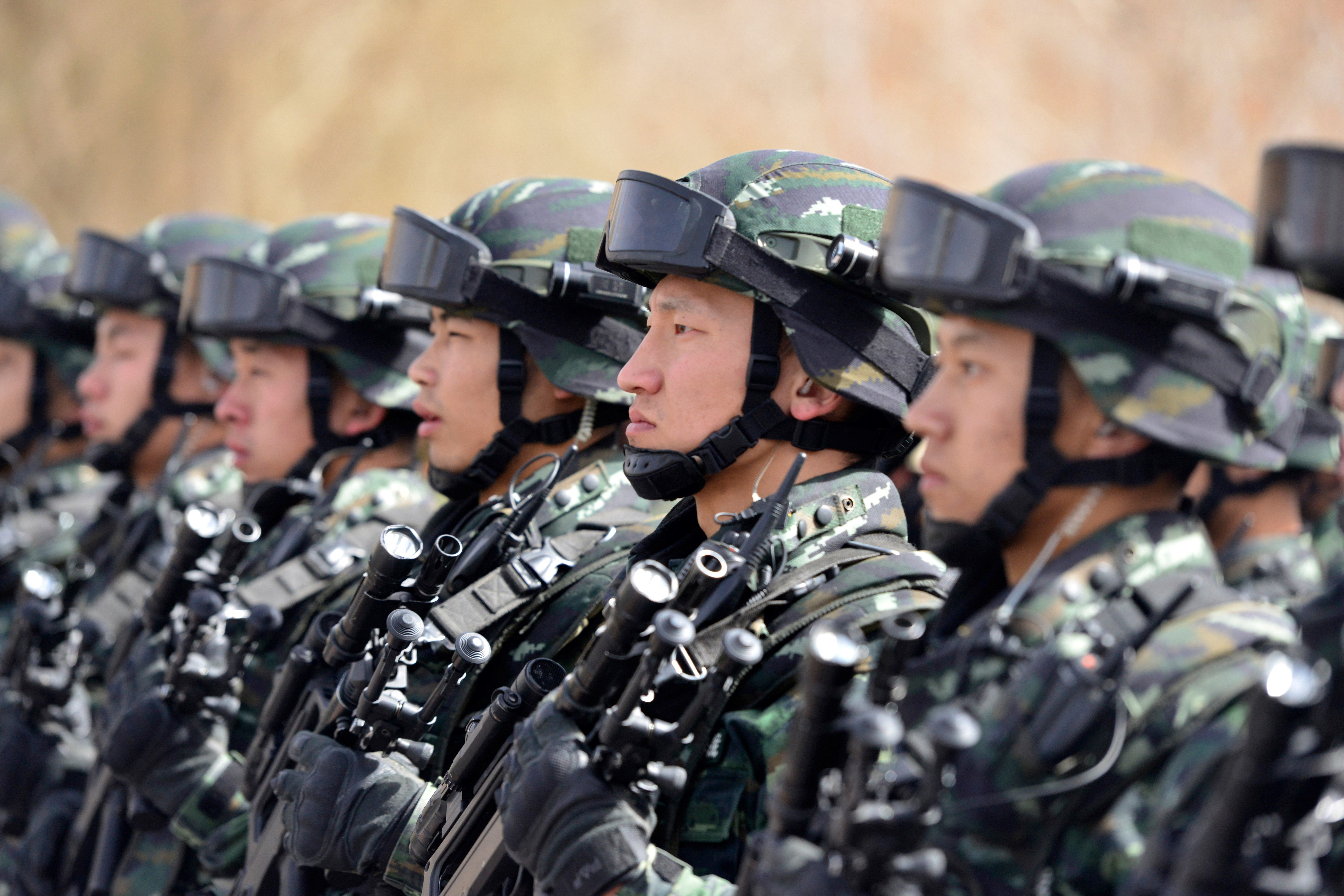 This photo taken on February 27, 2017 shows Chinese military police attending an anti-terrorist oath-taking rally in Hetian, northwest China's Xinjiang Uygur Autonomous Region.