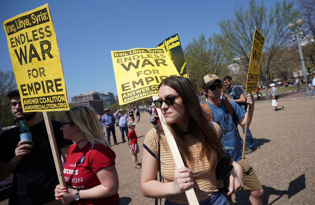 Demonstrators take part in a protest against the U.S. bombing of Syria in front of the White House on Apr. 14, 2018 in Washington, DC