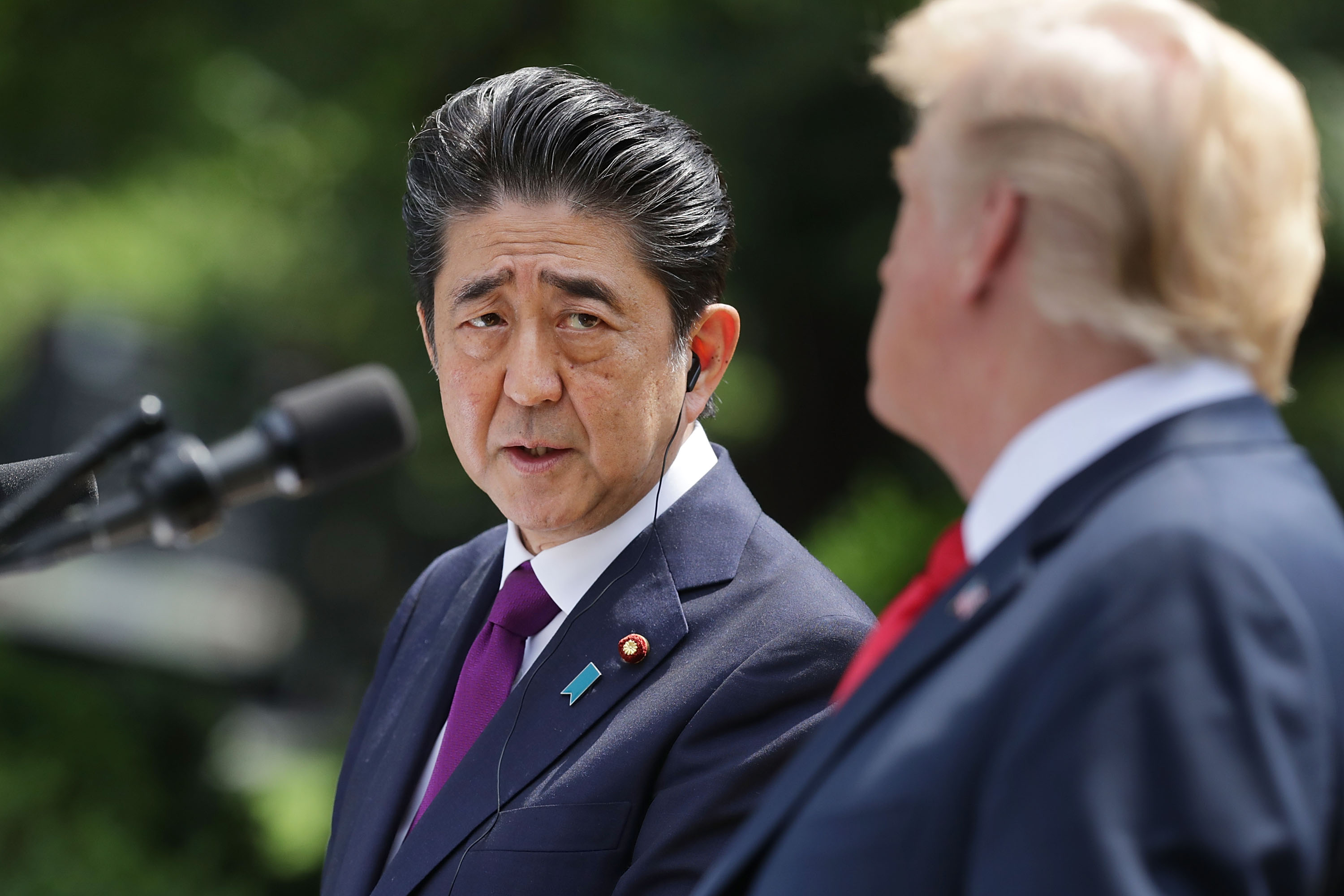 Japanese Prime Minister Shinzo Abe looks at President Donald Trump during a joint news conference at the White House on June 7, 2018 in Washington, DC.