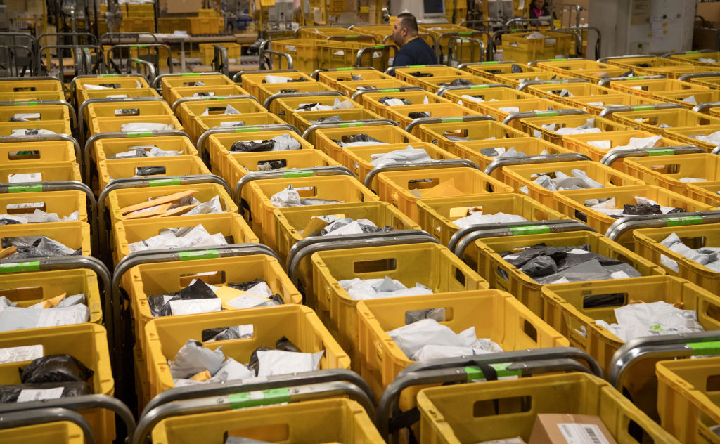 Post office workers sort international mail in the post office in the Frankfurt airport on Sept. 21, 2017.