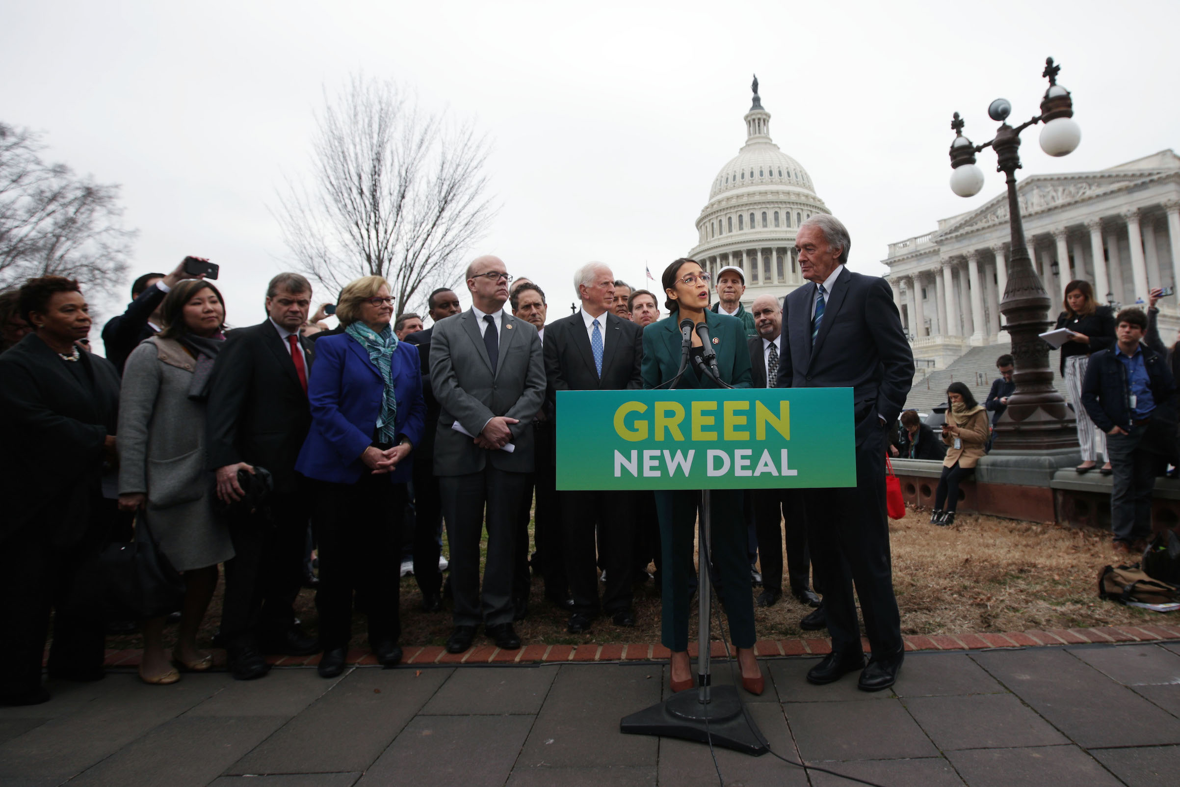 Rep. Alexandria Ocasio-Cortez speaks as Sen. Ed Markey and other Congressional Democrats listen during a news conference in front of the U.S. Capitol in Washington, on Feb. 7, 2019. Sen. Markey and Rep. Ocasio-Cortez held a news conference to unveil their Green New Deal resolution.