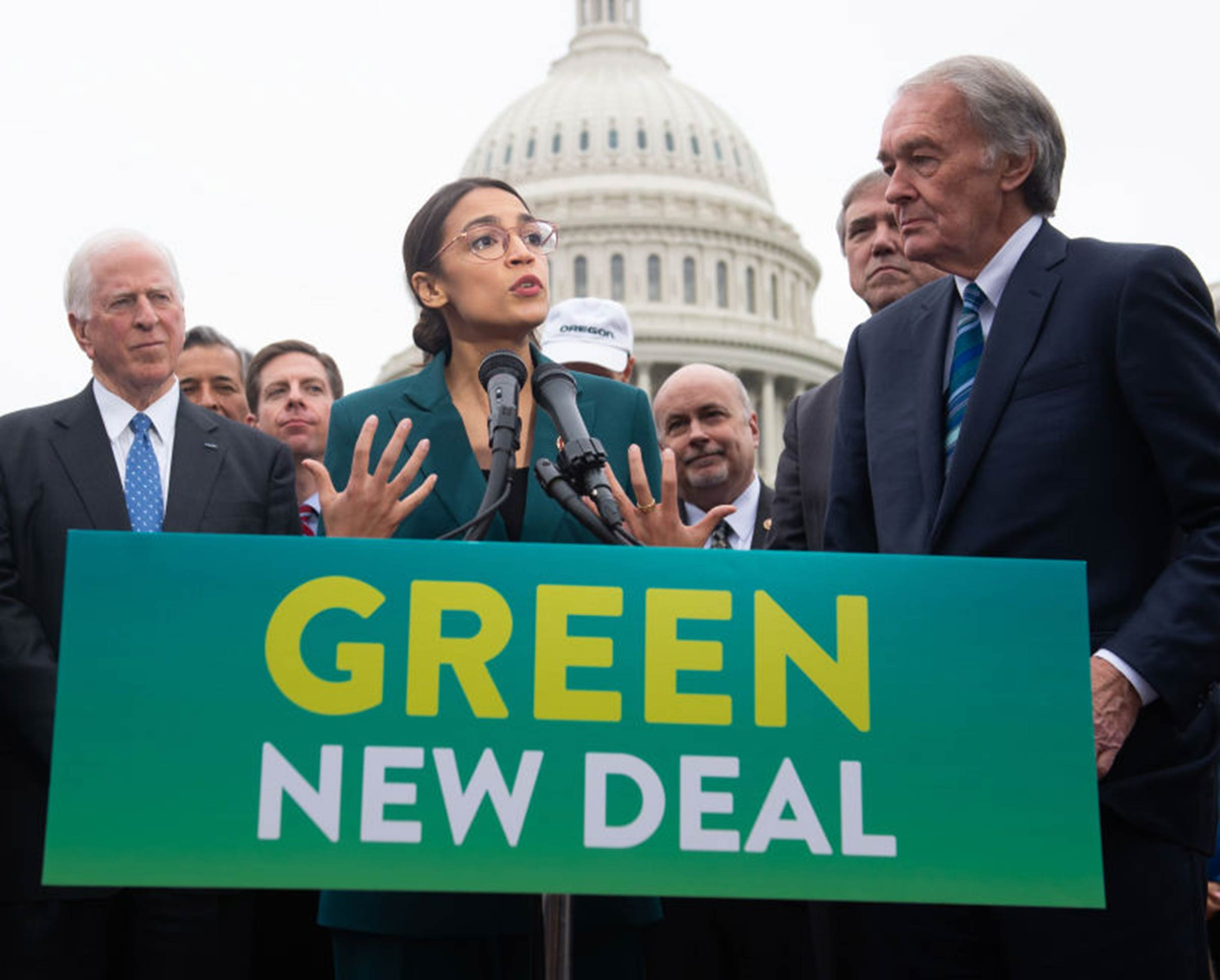 U.S. Representative Alexandria Ocasio-Cortez, Democrat of New York, and U.S. Senator Ed Markey (R), Democrat of Massachusetts, speak during a press conference to announce Green New Deal legislation to promote clean energy programs outside the U.S. Capitol in Washington, DC, on Feb. 7, 2019.