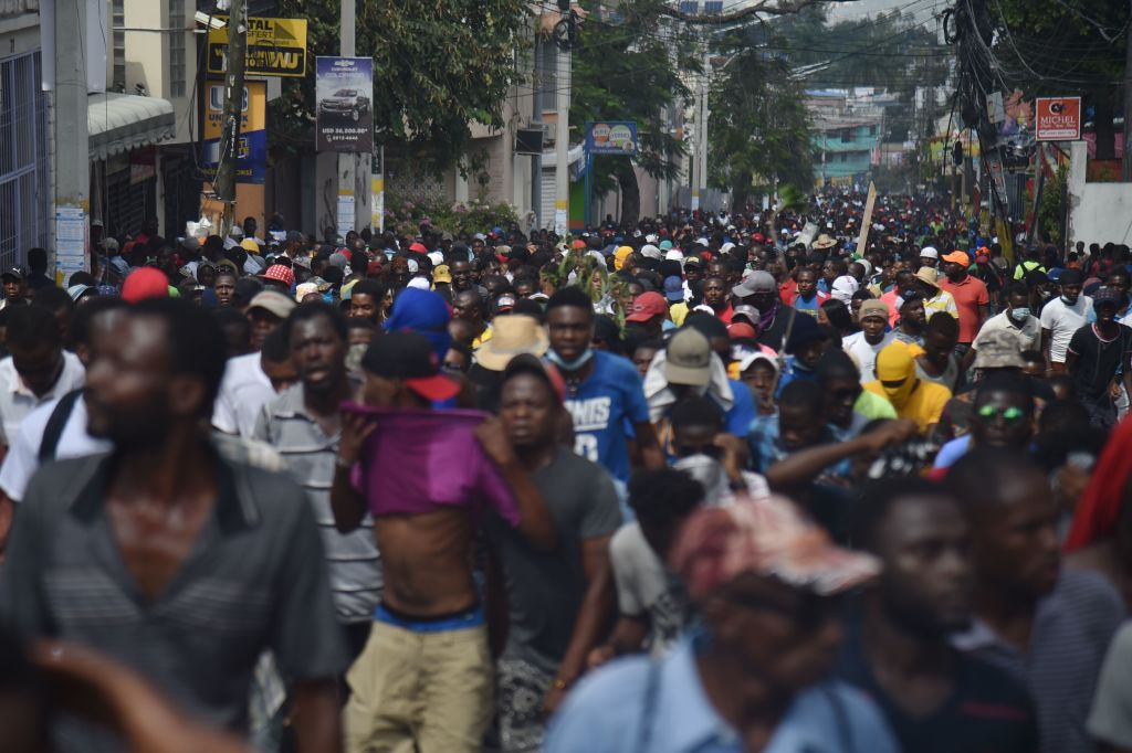 Demonstrators march through the streets of Port-au-Prince, on February 7, 2019.