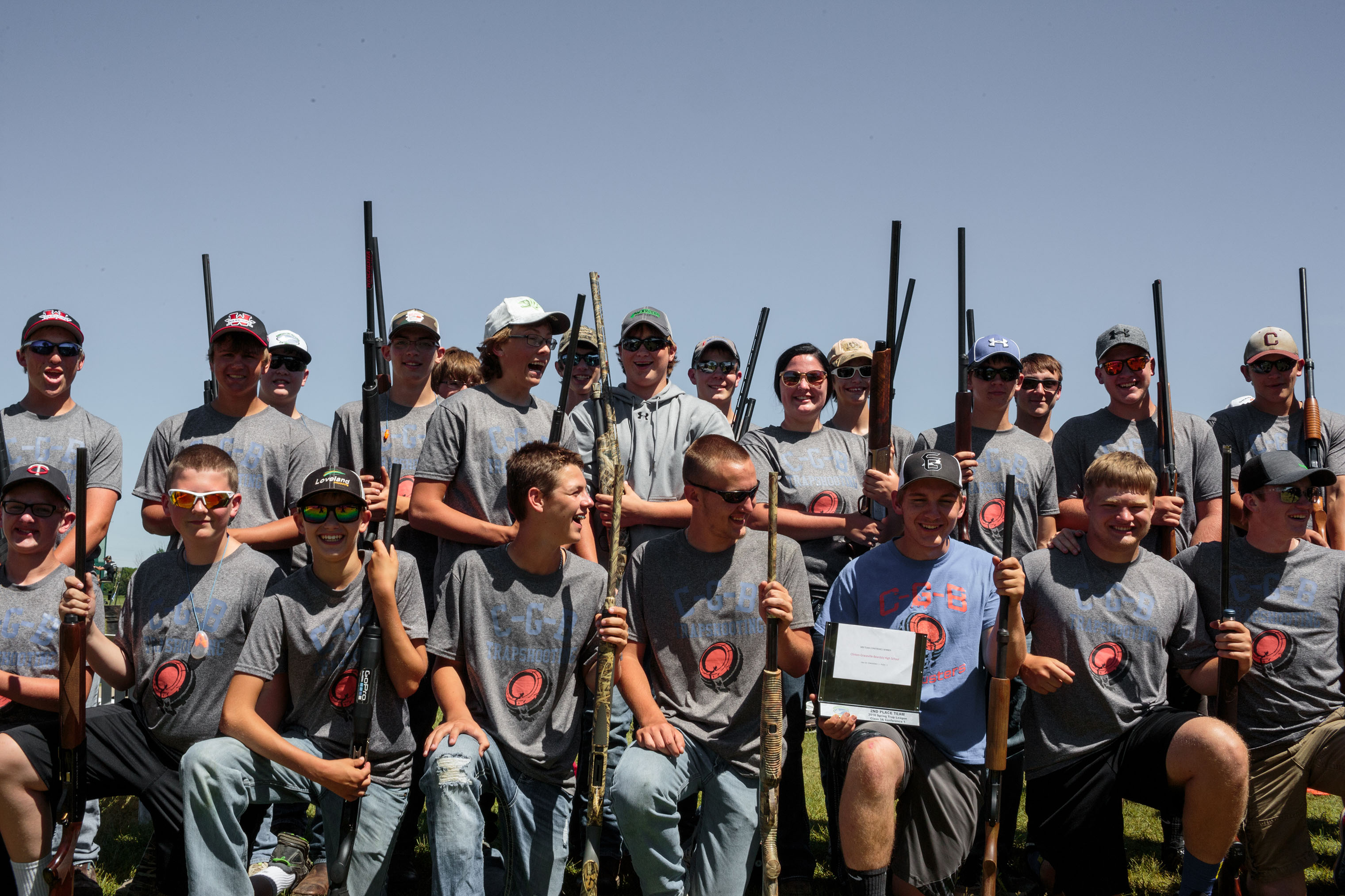 The C-G-B Trapshooting team lines up for a team photo.