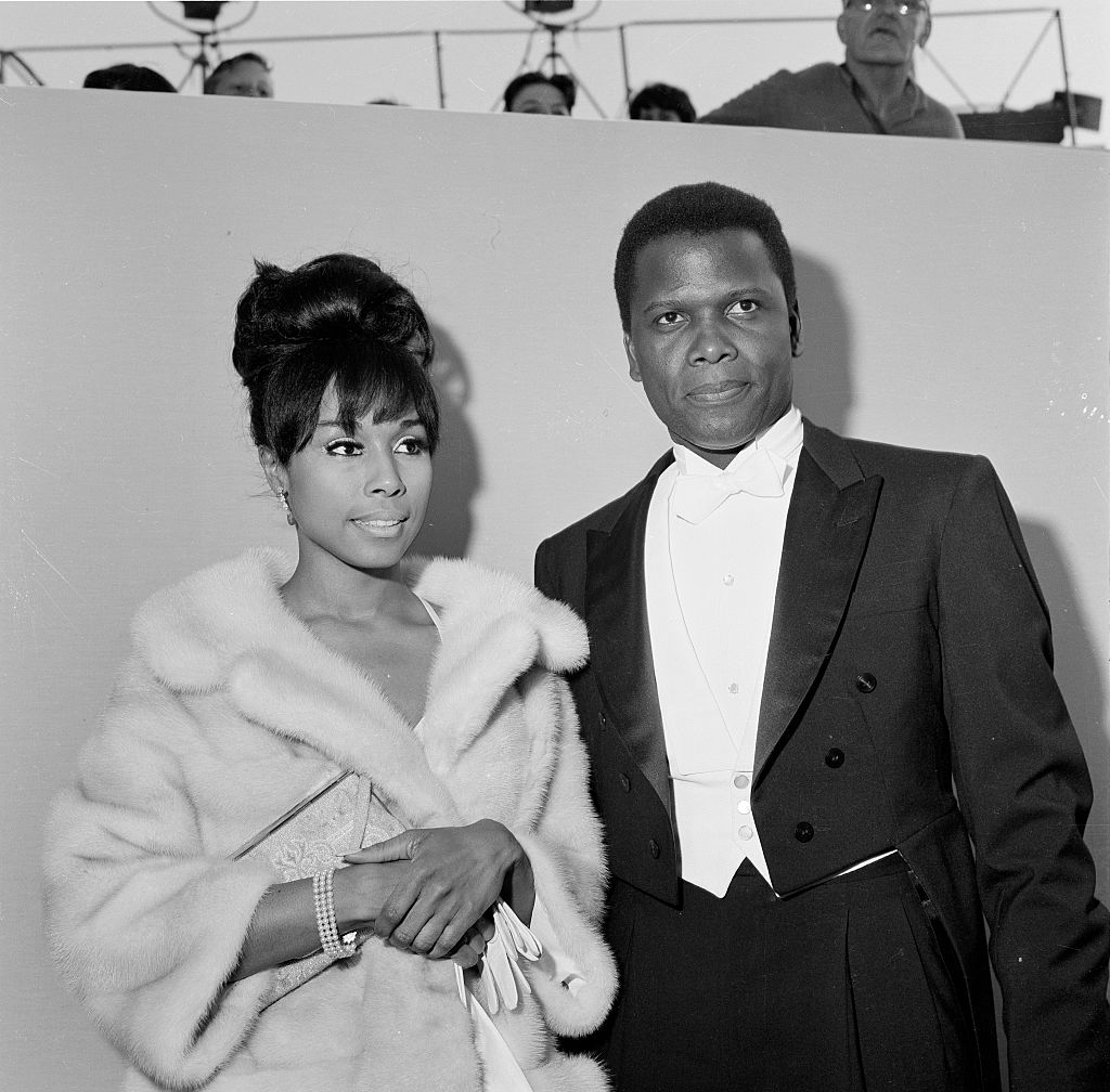 Actor Sidney Poitier with actress Diahann Carroll attend The 36th Academy Awards in Santa Monica, Calif., on April 13, 1964.
