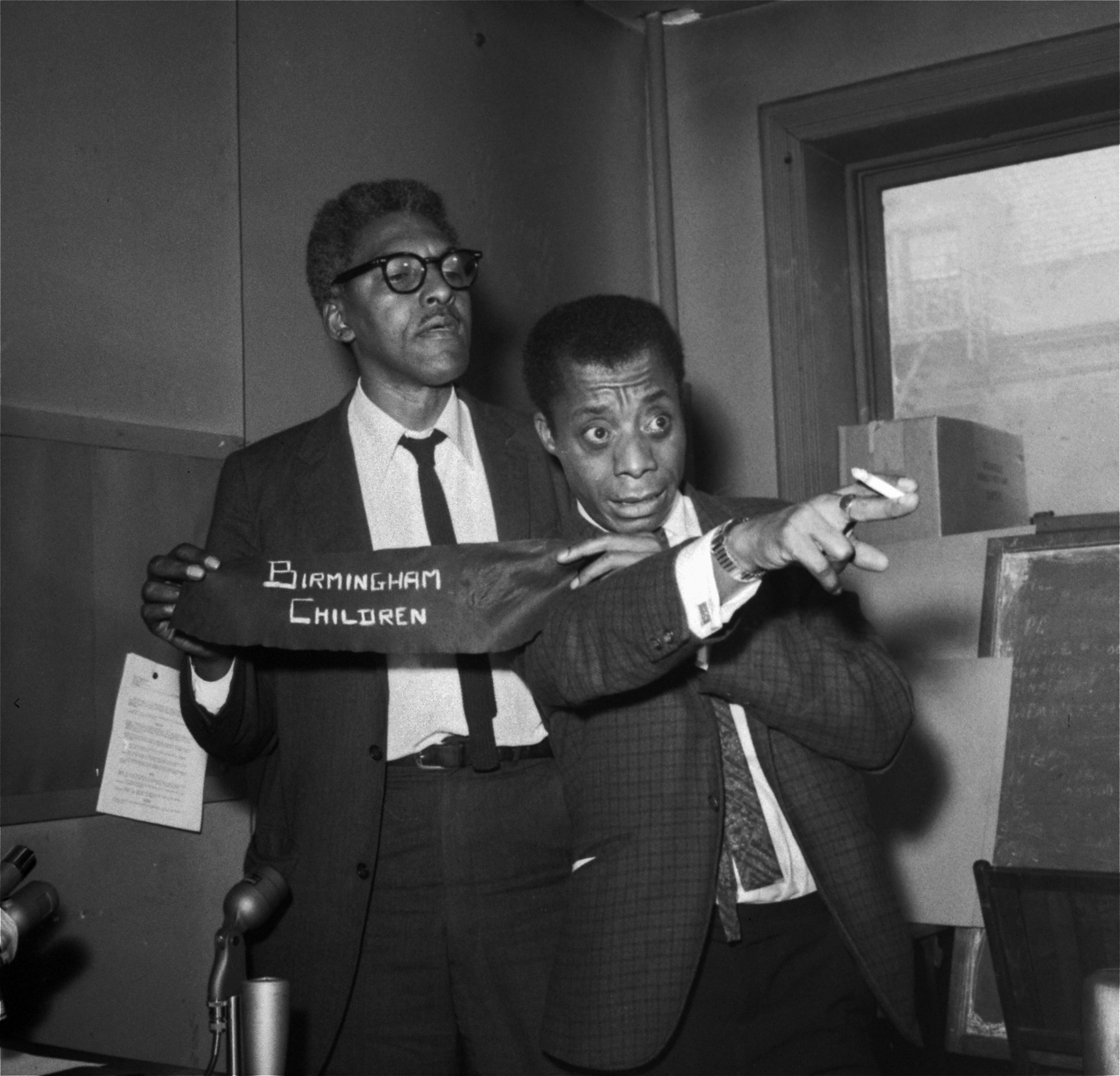 James Baldwin, right, and Bayard Rustin, deputy director of the March on Washington, discussing the 16th Street Baptist Church bombing that killed four young African-American girls in Birmingham, Ala., during a news conference in New York three days later, on Sept. 18, 1963. Rustin is holding an armband that people would be wearing at an upcoming rally organized as a day of mourning for the victims.