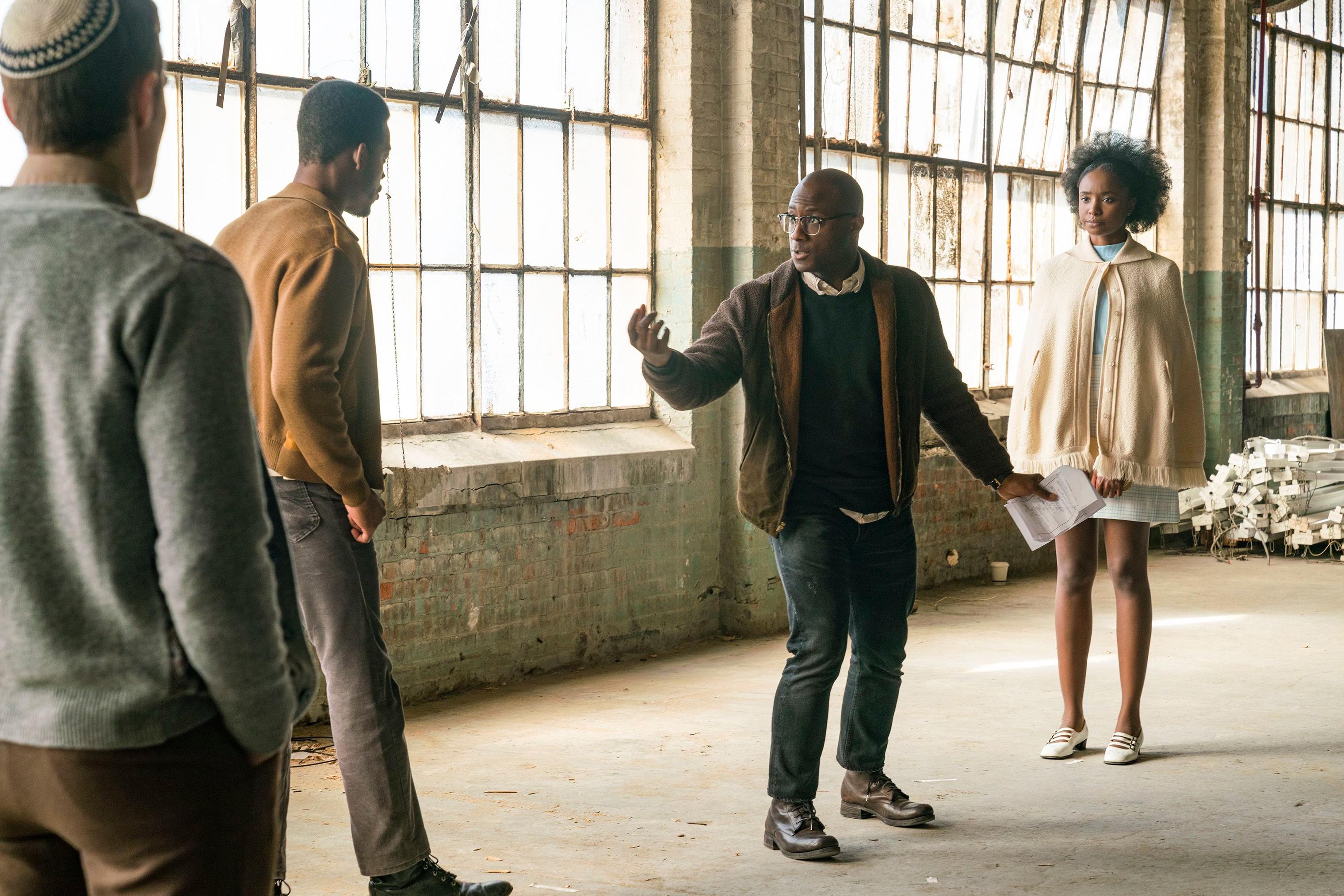Director Barry Jenkins, center, works with actors Stephan James, left, and KiKi Layne on the set of If Beale Street Could Talk