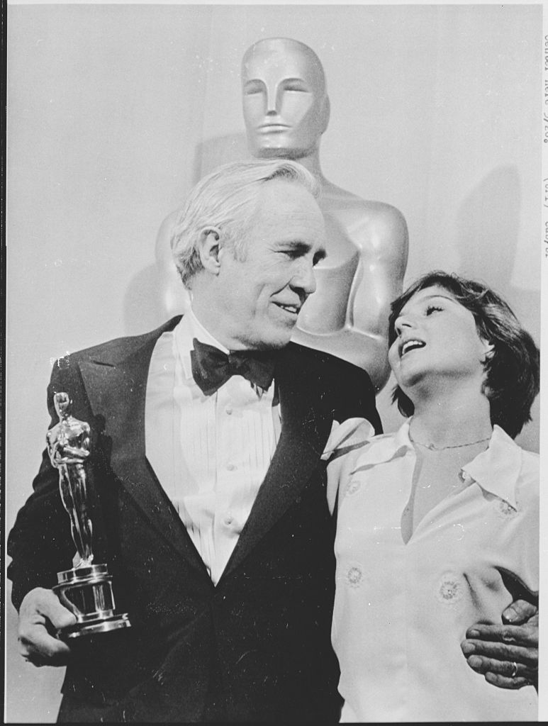 Actor Jason Robards hugs actress Tatum O'Neal, who presented him with the Best Supporting Actor Oscar for his role in All the President's Men. Robards' presentation was the first of the evening at the 49th Annual Academy Awards on March 28, 1977.