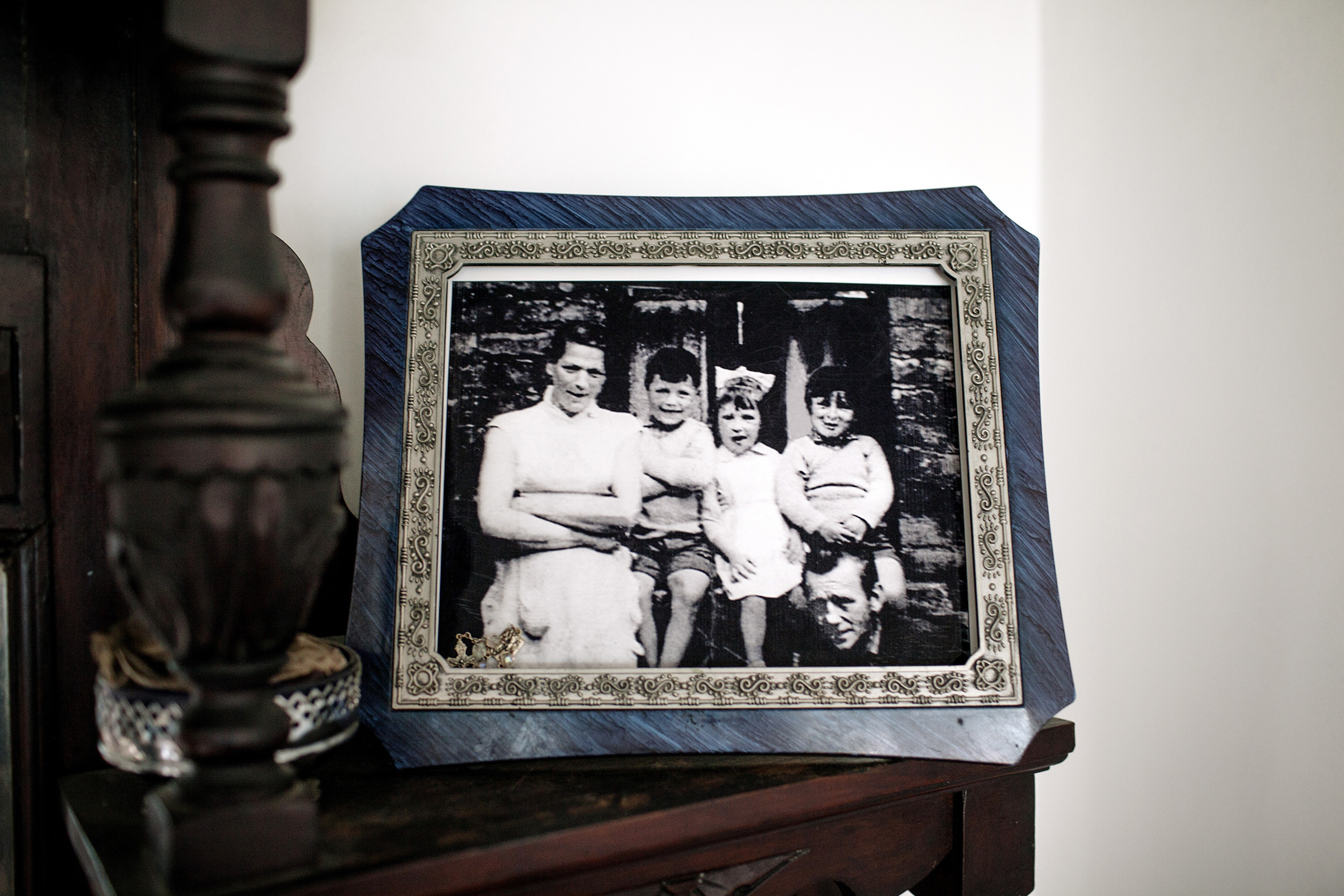 A portrait of the McConville family in the home of Helen McKendry, daughter of Jean McConville (left), a widowed Belfast mother of 10 who was killed in 1972.