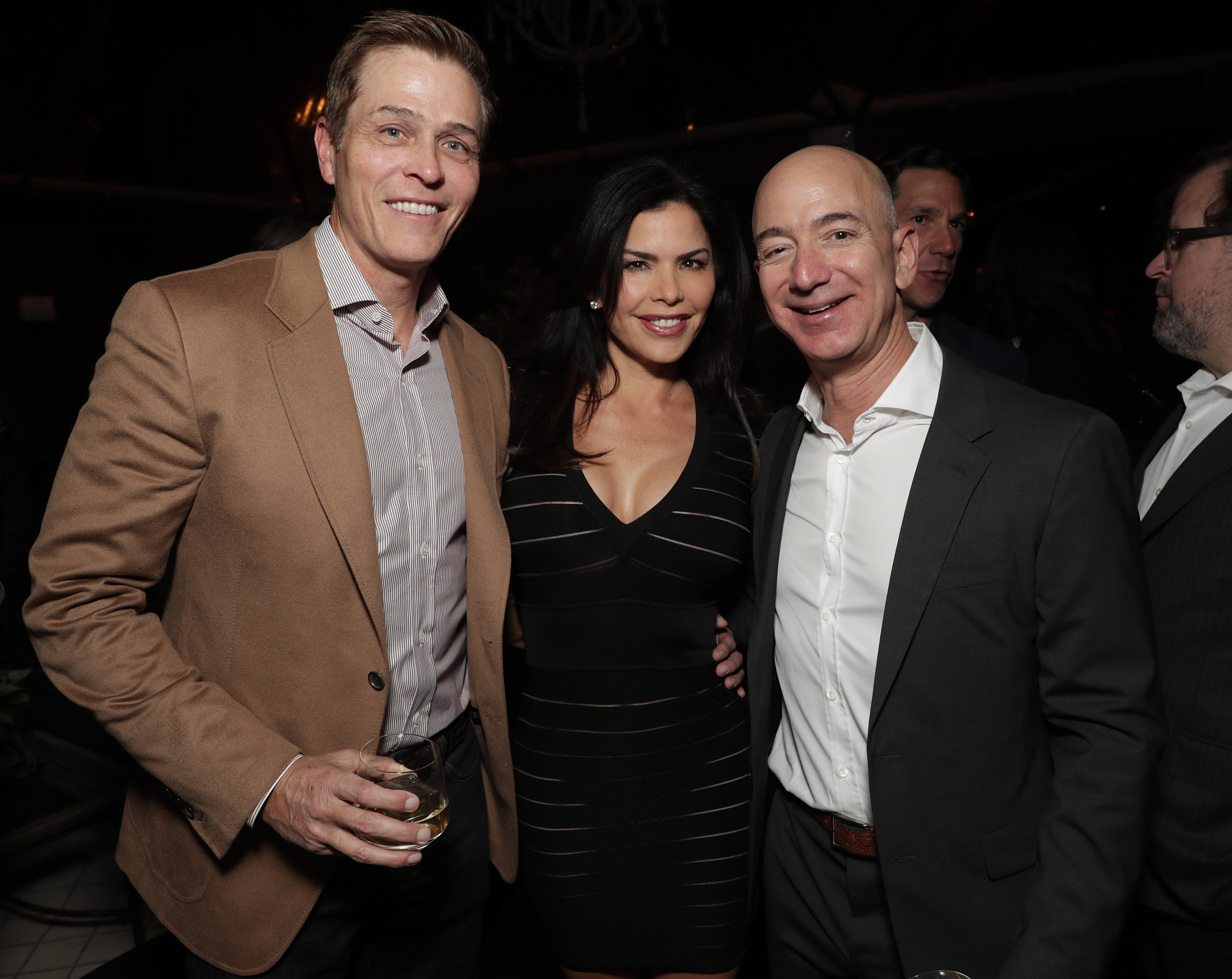 WME's Patrick Whitesell, Lauren Sanchez and Amazon CEO Jeff Bezos attend Jeff Bezos and Matt Damon's  Manchester By The Sea  Holiday Party on Dec. 3, 2016 in Los Angeles, California.