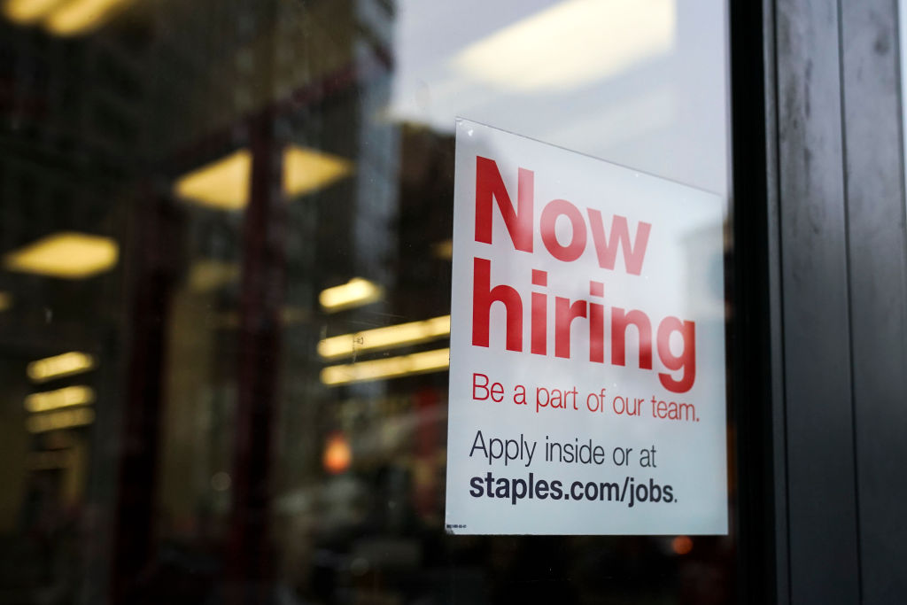 A 'now hiring' sign hangs on the door of a Staples store in Lower Manhattan on Jan. 4, 2019 in New York City.