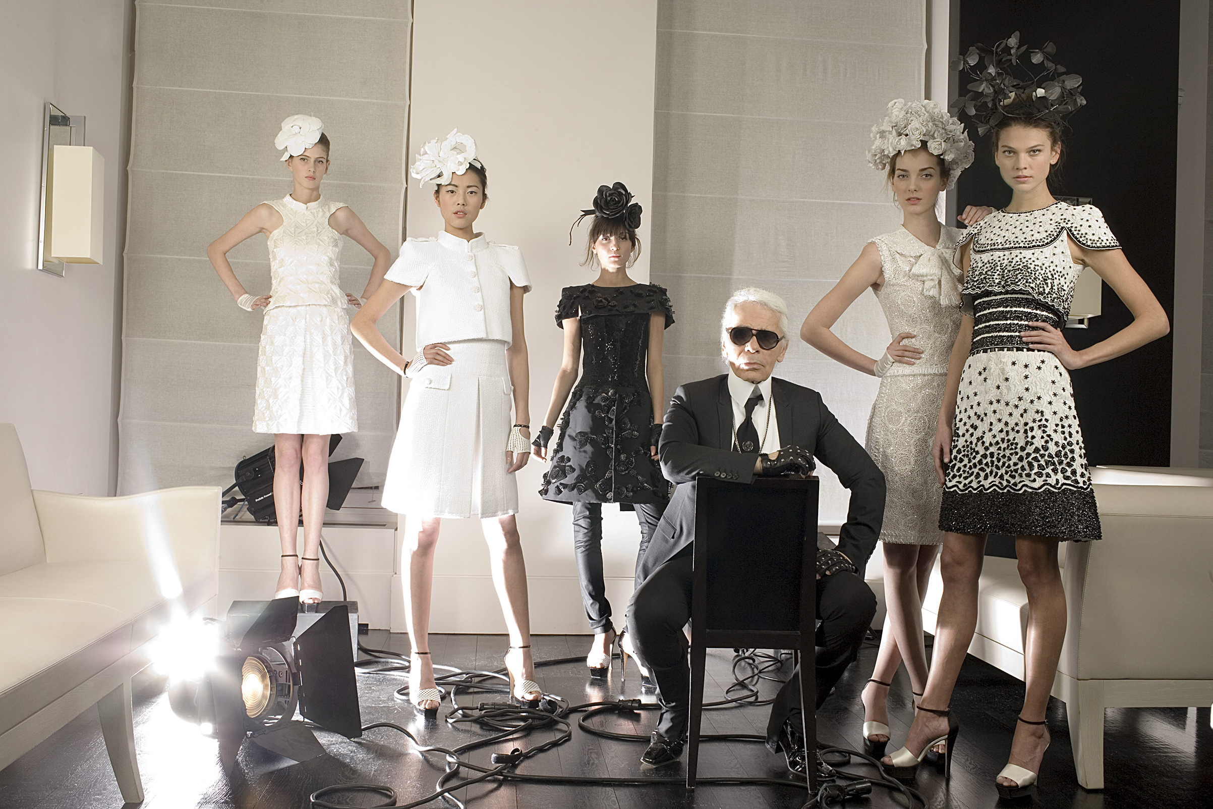 Lagerfeld in Paris in 2009 with models wearing his work for Chanel