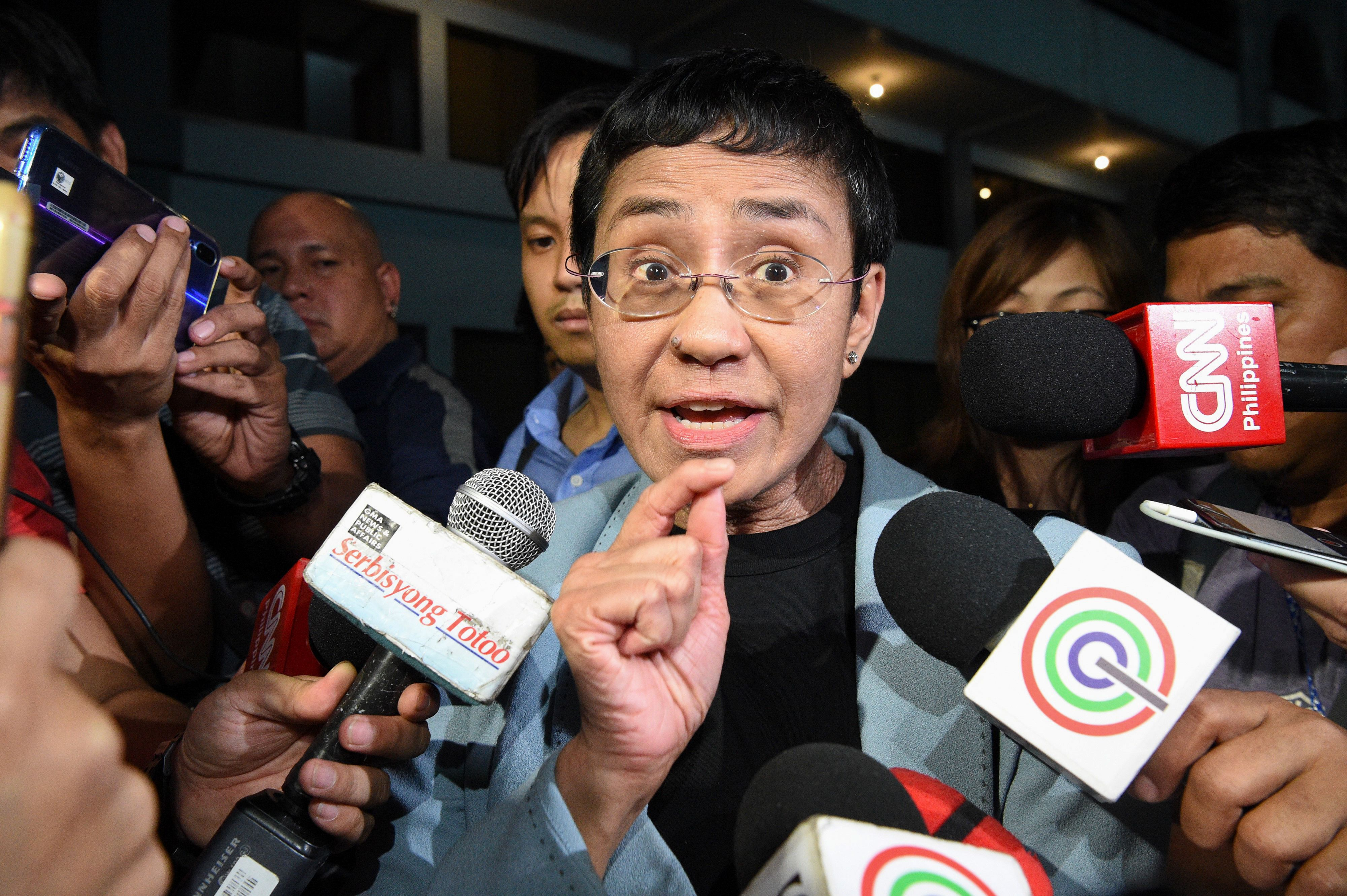 Journalist Maria Ressa speaks to the media as she arrives at the National Bureau of Investigation headquarters after her arrest in Manila on Feb. 13, 2019.