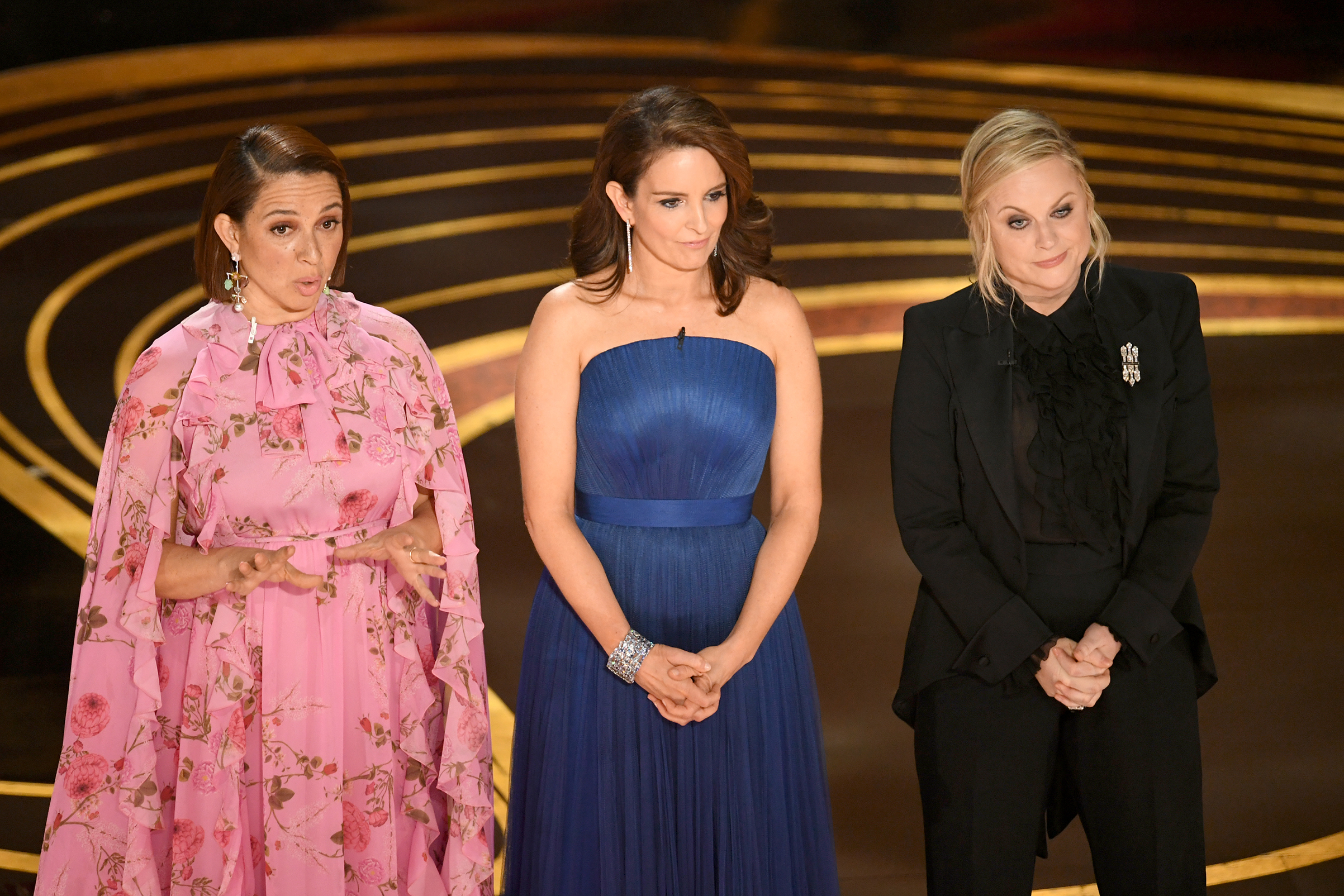Maya Rudolph, Tina Fey, and Amy Poehler speak onstage during the 91st Annual Academy Awards at Dolby Theatre on Feb. 24, 2019.