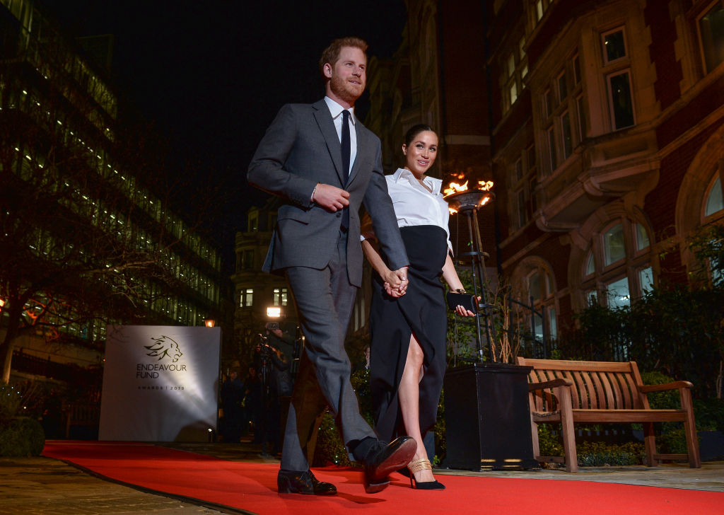 The Duke and Duchess of Sussex walk on the red carpet at the Endeavour Fund awards at Drapers' Hall on Feb. 7, 2019, in London.