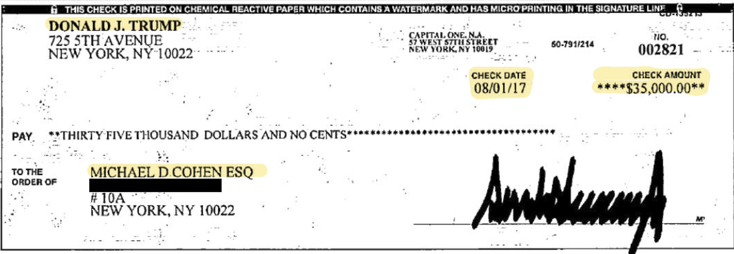 This image provided by Michael Cohen's attorney, Lanny Davis, shows copies of two checks that Cohen presented to the House Oversight and Reform Committee on Wednesday, Feb. 27, 2019 in Washington.