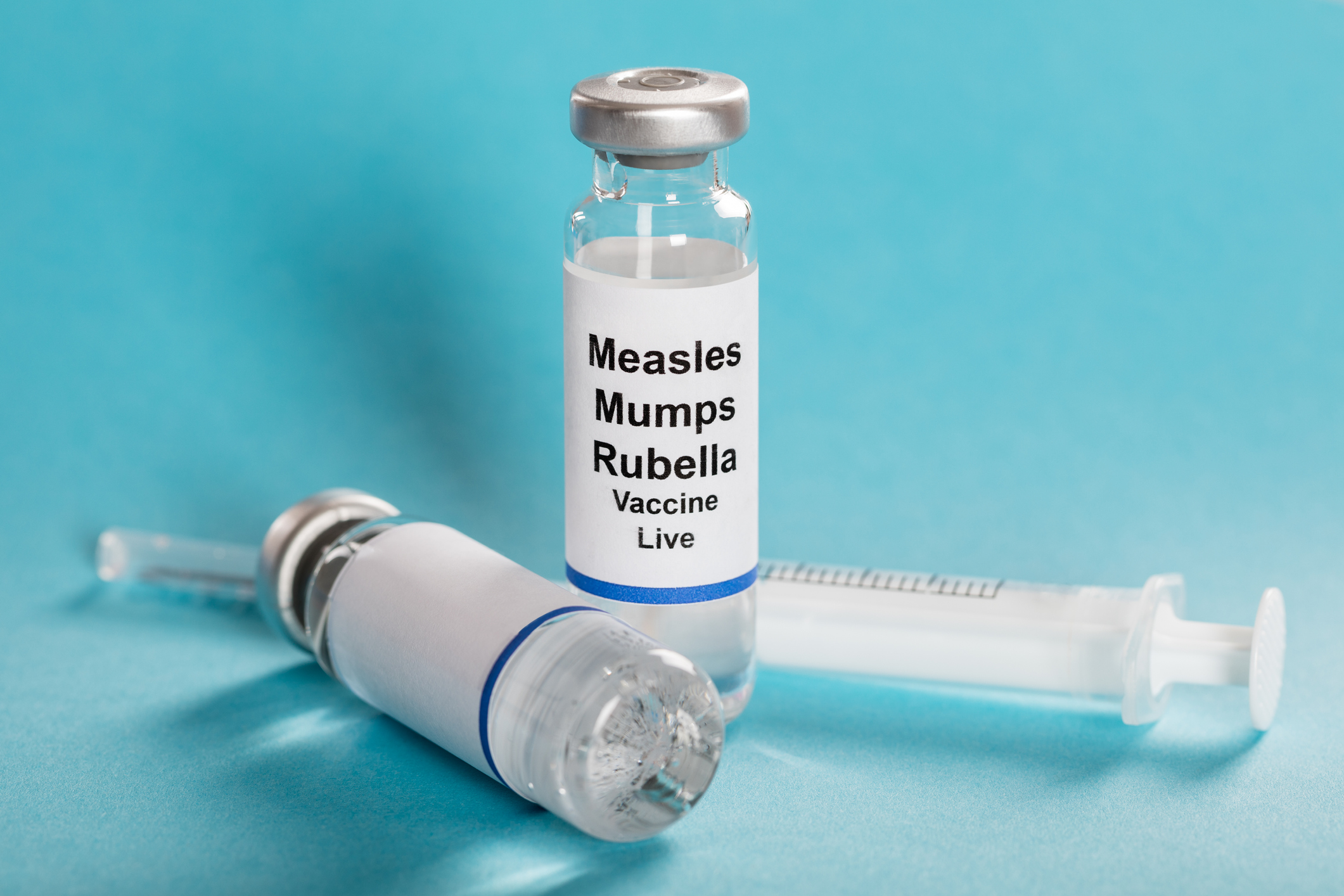 Measles Mumps Rubella (MMR) Vaccine Vials With Syringe.