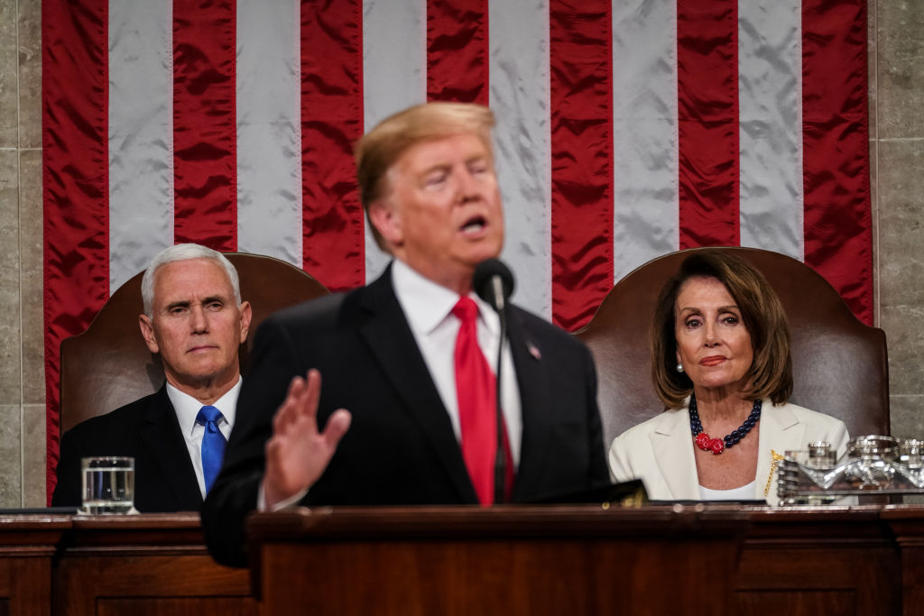 Speaker Nancy Pelosi and Vice President Mike Pence look on as U.S. President Donald Trump delivers the State of the Union address in the chamber of the U.S. House of Representatives at the U.S. Capitol Building on February 5, 2019 in Washington, DC.