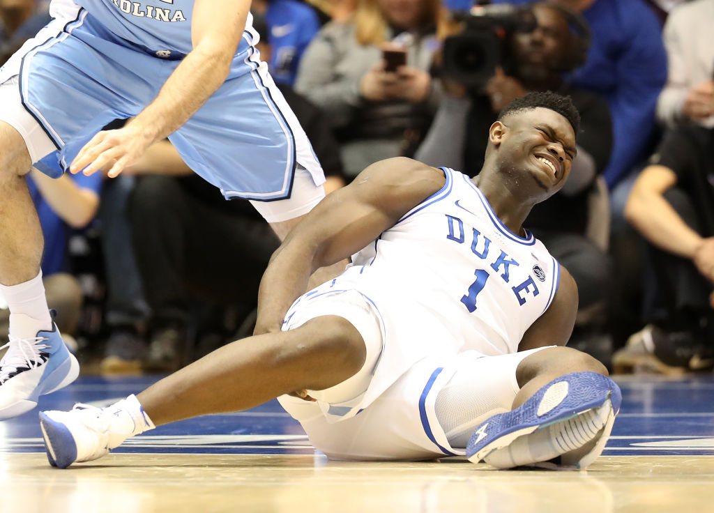 Zion Williamson #1 of the Duke Blue Devils reacts after falling as his shoe breaks against Luke Maye #32 of the North Carolina Tar Heels during their game at Cameron Indoor Stadium on Feb. 20, 2019 in Durham, North Carolina. Nike is looking into what caused the shoe to break as the stock falls by 1.7% on Feb. 21, 2019.