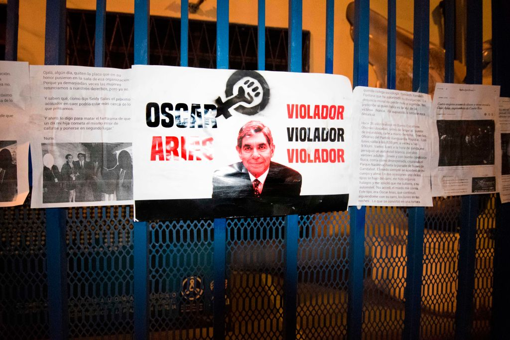 Signs at the entrance of the Arias Foundation for Peace. Nobel Peace Prize winner and Costa Rica's former President, Oscar Arias, has been accused of sexual assault. San Jose, Costa Rica, Feb. 8, 2019.