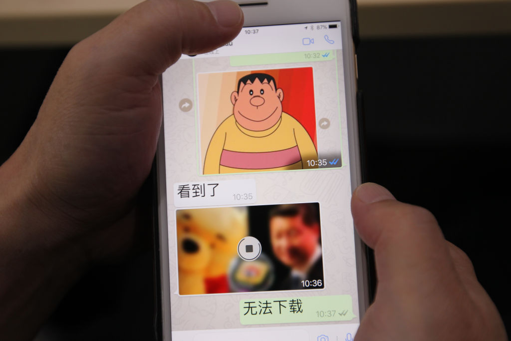 A photo taken of the screen of a smart phone using whatsapp shows a clear image of Japanese cartoon character Takeshi Goda and murky image of Xi Jinping and Winnie the Pooh in Beijing on Jul. 19, 2017.