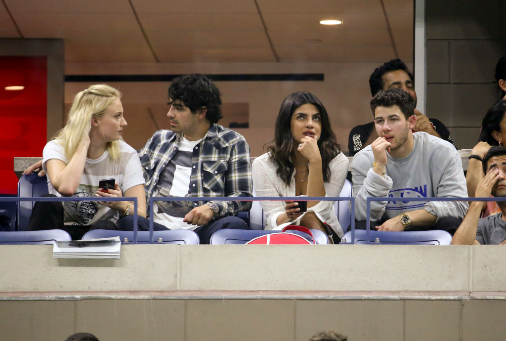 NEW YORK, NY - SEPTEMBER 4: Sophie Turner and boyfrend Joe Jonas, Priyanka Chopra, wearing her engagement ring and her fiance Nick Jonas attend Serena Williams' quarter-final victory on day 9 of the 2018 tennis US Open on Arthur Ashe stadium at the USTA Billie Jean King National Tennis Center on September 4, 2018 in Flushing Meadows, Queens, New York City. (Photo by Jean Catuffe/GC Images)