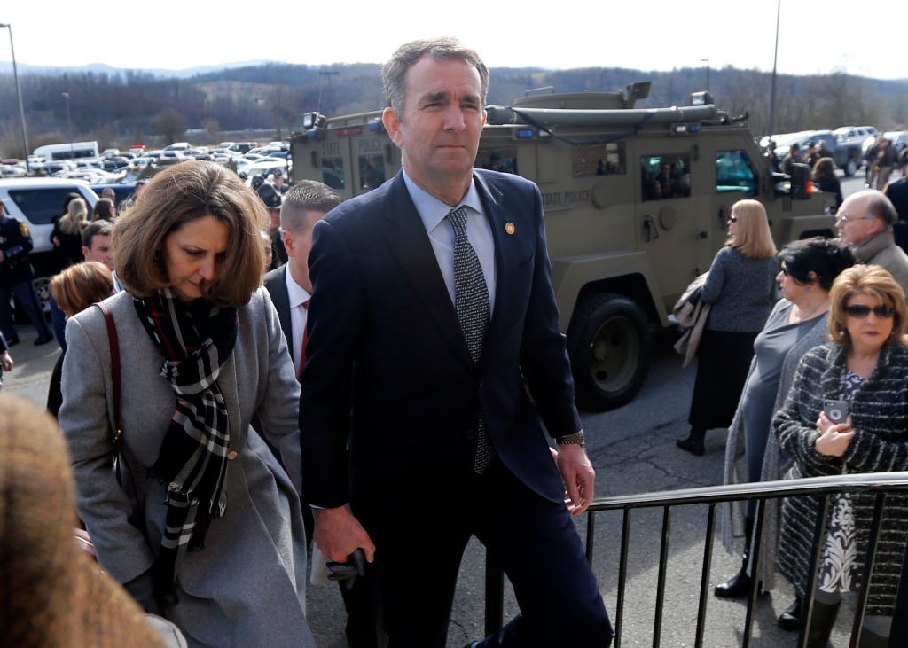Virginia Gov. Ralph Northam, left,  and his wife Pam, left, leave the funeral of fallen Virginia State Trooper Lucas B. Dowell after the church service for the funeral at the Chilhowie Christian Church on Feb. 9, 2019 in Chilhowie, Virginia. In an interview with the Washington Post on Feb. 9, 2019 he said he will not resign but he will use the rest of his term to work on racial  equity .