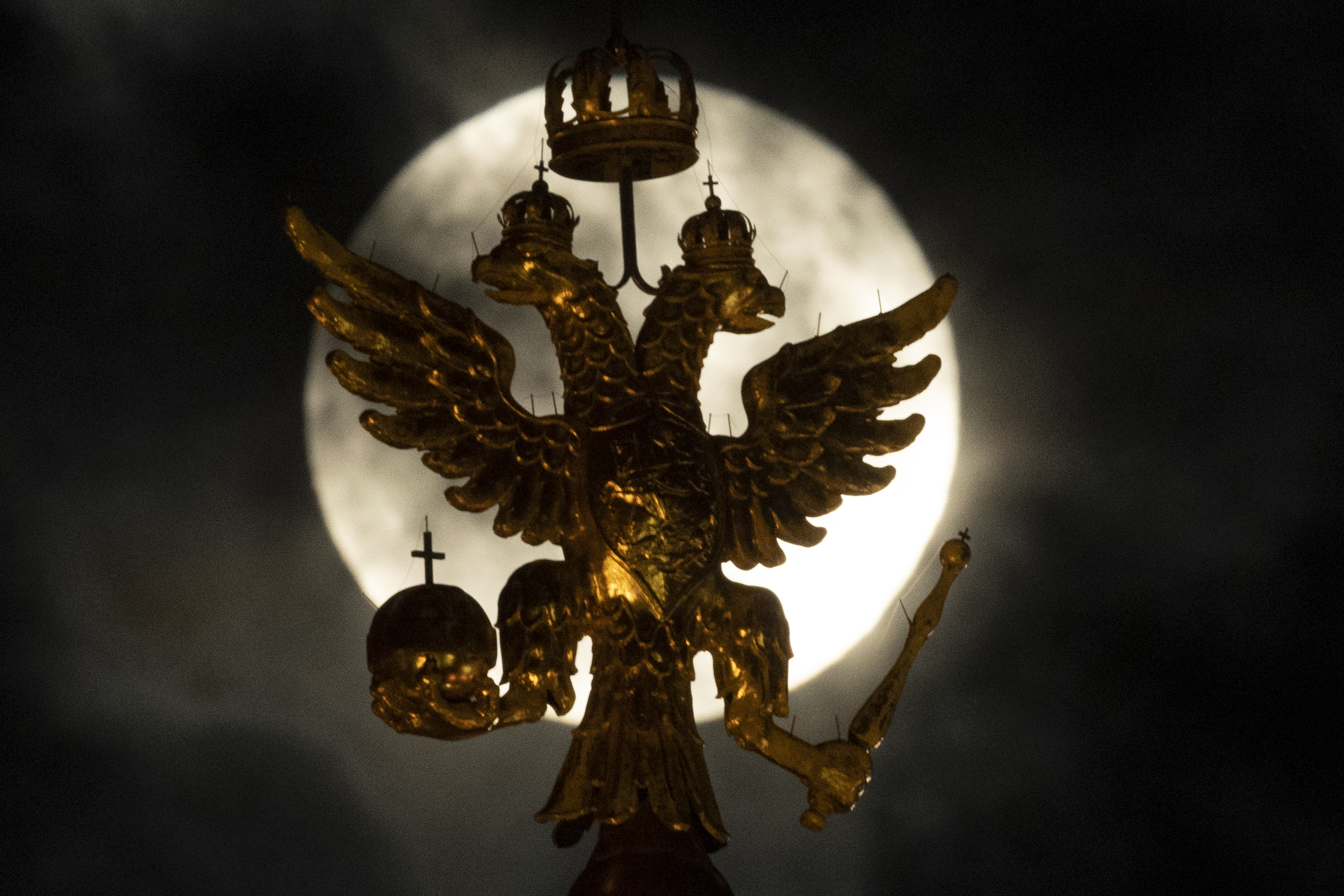 Feb. 19, 2019. Russia's state symbol, the double-headed eagle, is pictured against the full moon, in Moscow, Russia.