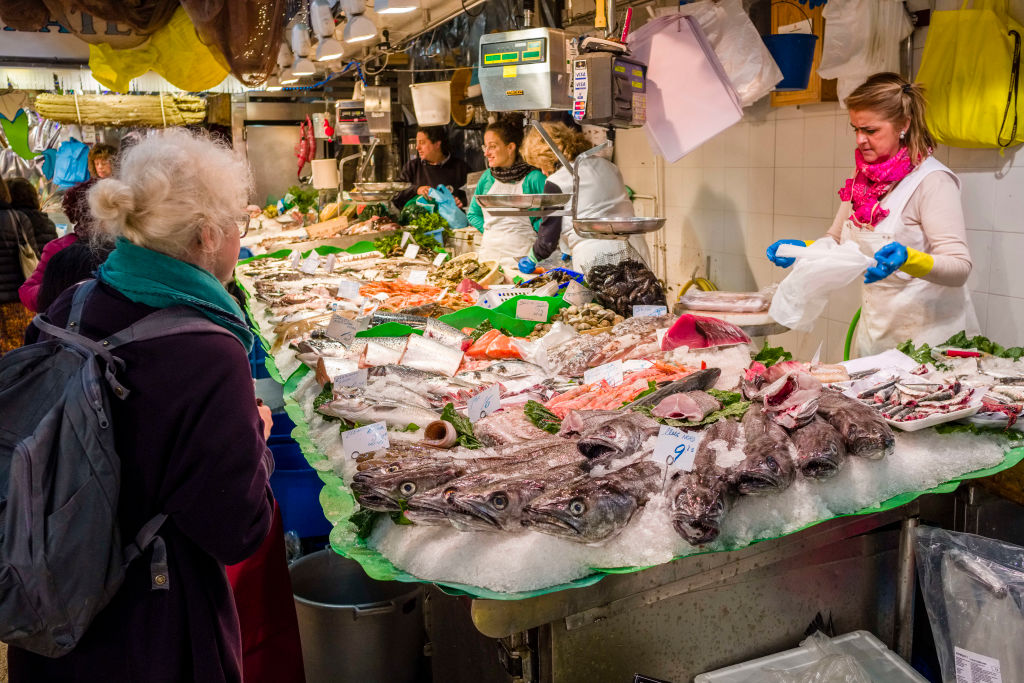 Different sorts of fresh fish are sold inside the Mercat de la Llibertat in the Spanish suburb of Vila de Gràcia on April 14, 2018. Researchers say eating habits may provide clues to health levels enjoyed by Spain, now the healthiest country in the world, according to a Bloomberg index.