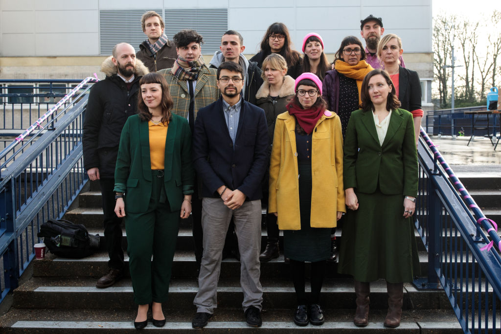 Members of the so-called 'Stansted 15' stand for a photograph outside Chelmsford Crown Court ahead of their sentencing on February 6, 2019 in Chelmsford, England.