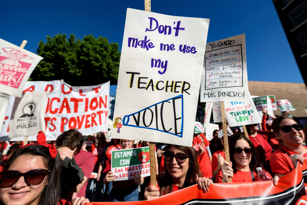 Teachers and supporters of public education march against education funding cuts during the March for Public Education in Los Angeles, California on Dec. 15, 2018. The rally, organized by United Teachers Los Angeles, drew thousands of educators who demanded wage increases and smaller class sizes.