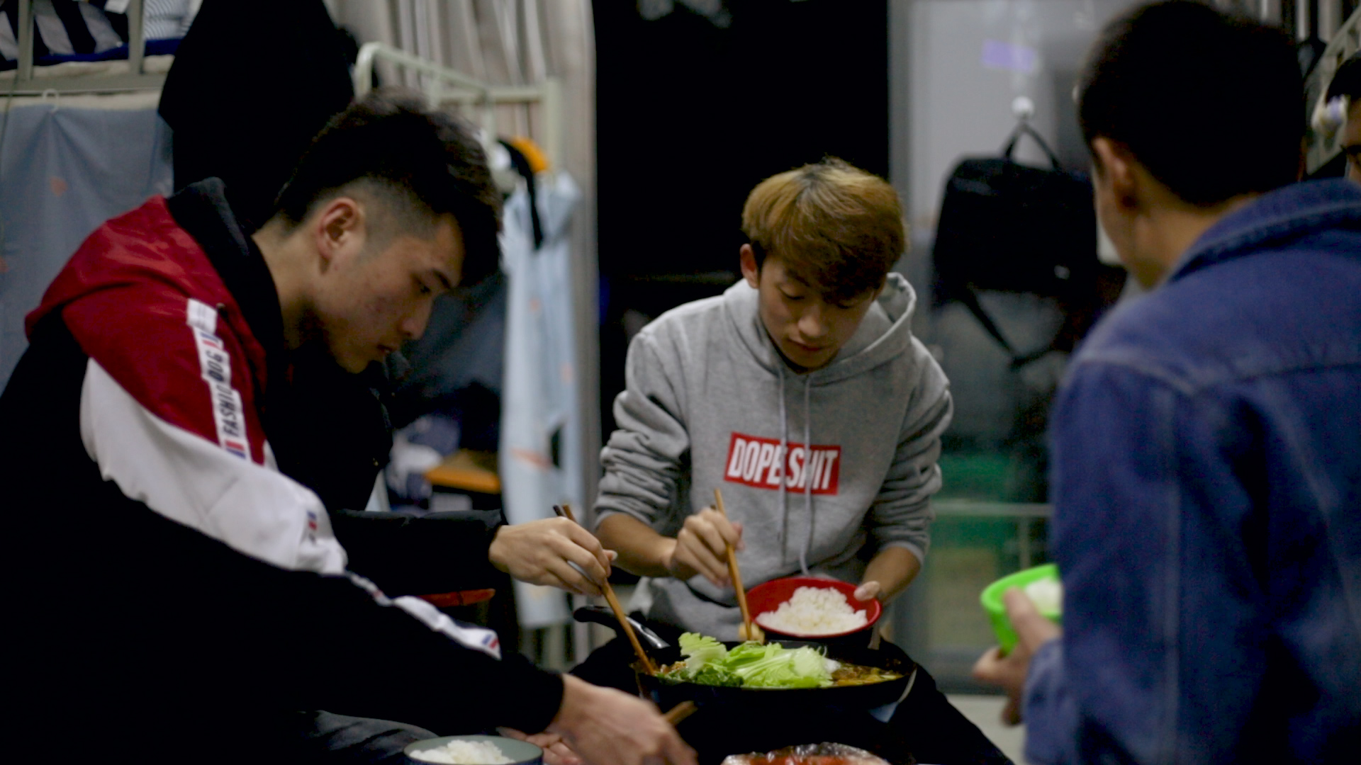 Yin You (C), 20, a tagger at an AI farm, has dinner with colleagues in the company dorm at Bainiaohe Digital Town in Guizhou, China, on Dec. 4, 2018